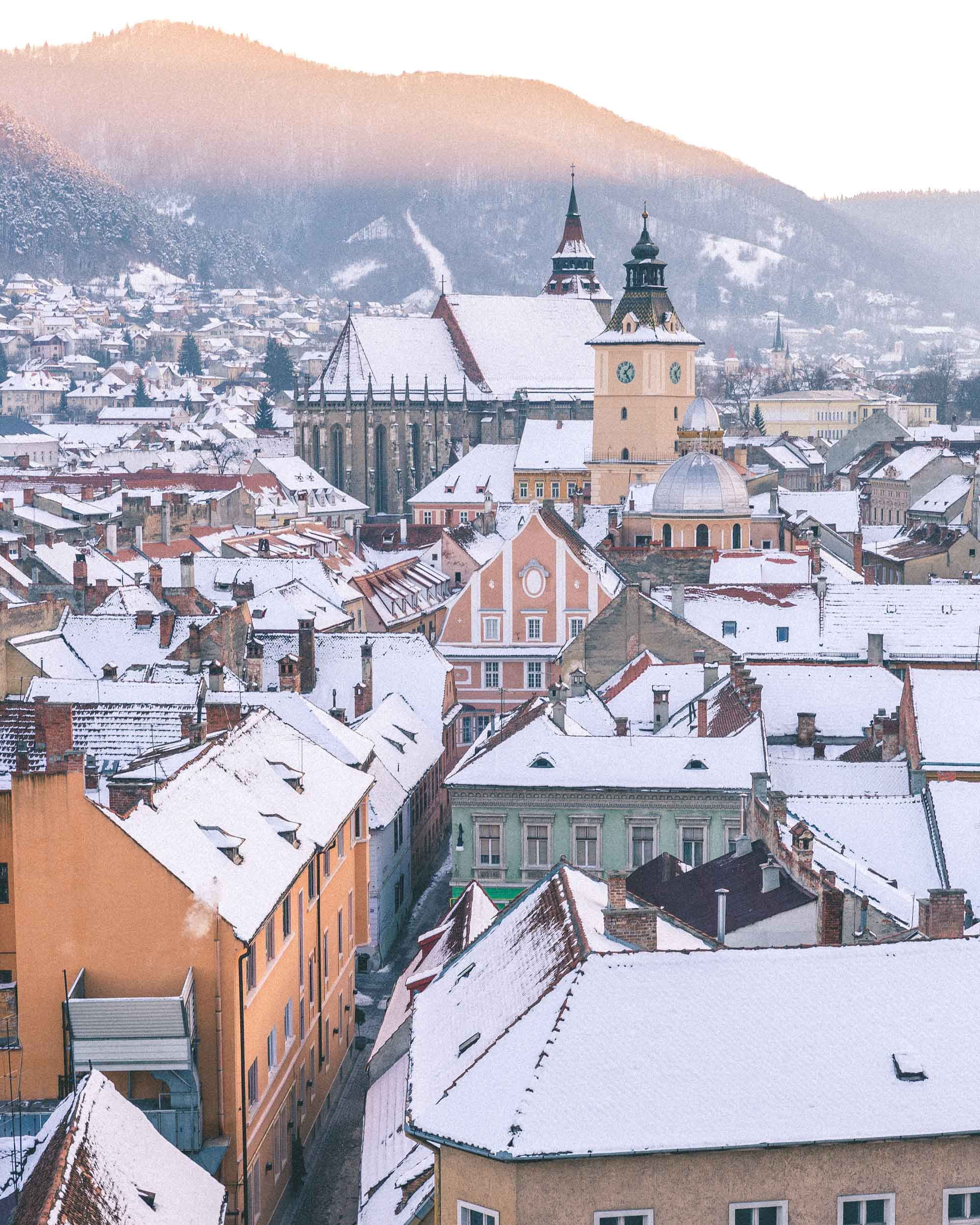 sunset views best place to watch sun go down pastel city of brasov poiana ski town church main square council wandering streets of tranyslvania romania