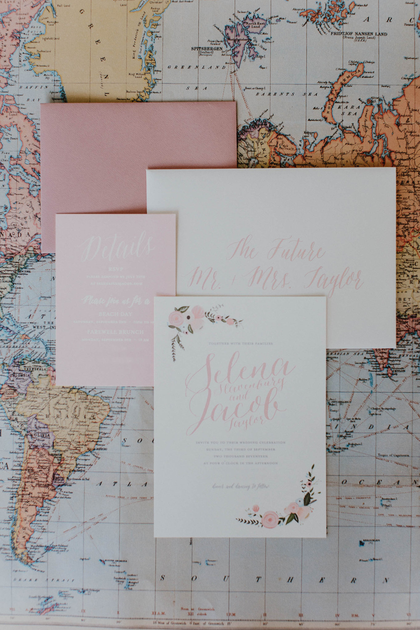 Travel themed wedding invitations invites with map background floral accents