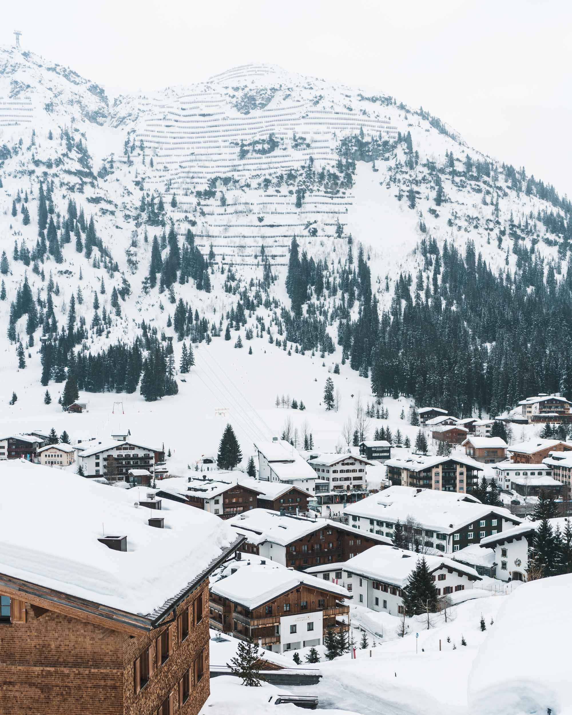 Snow-covered rooftops of hotels and restaurants downtown Lech Austria Ski Town