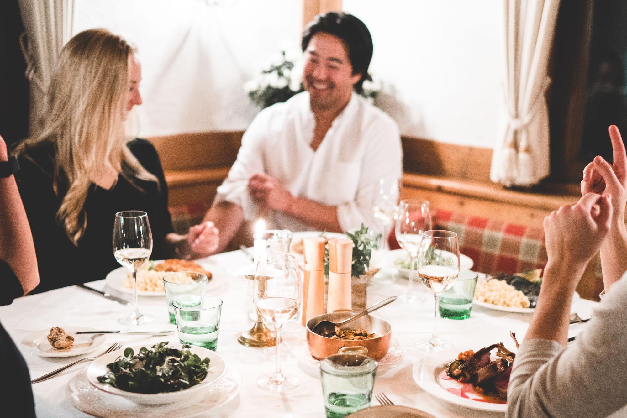 Friends at dinner at Austrian Restaurant in Lech Austria