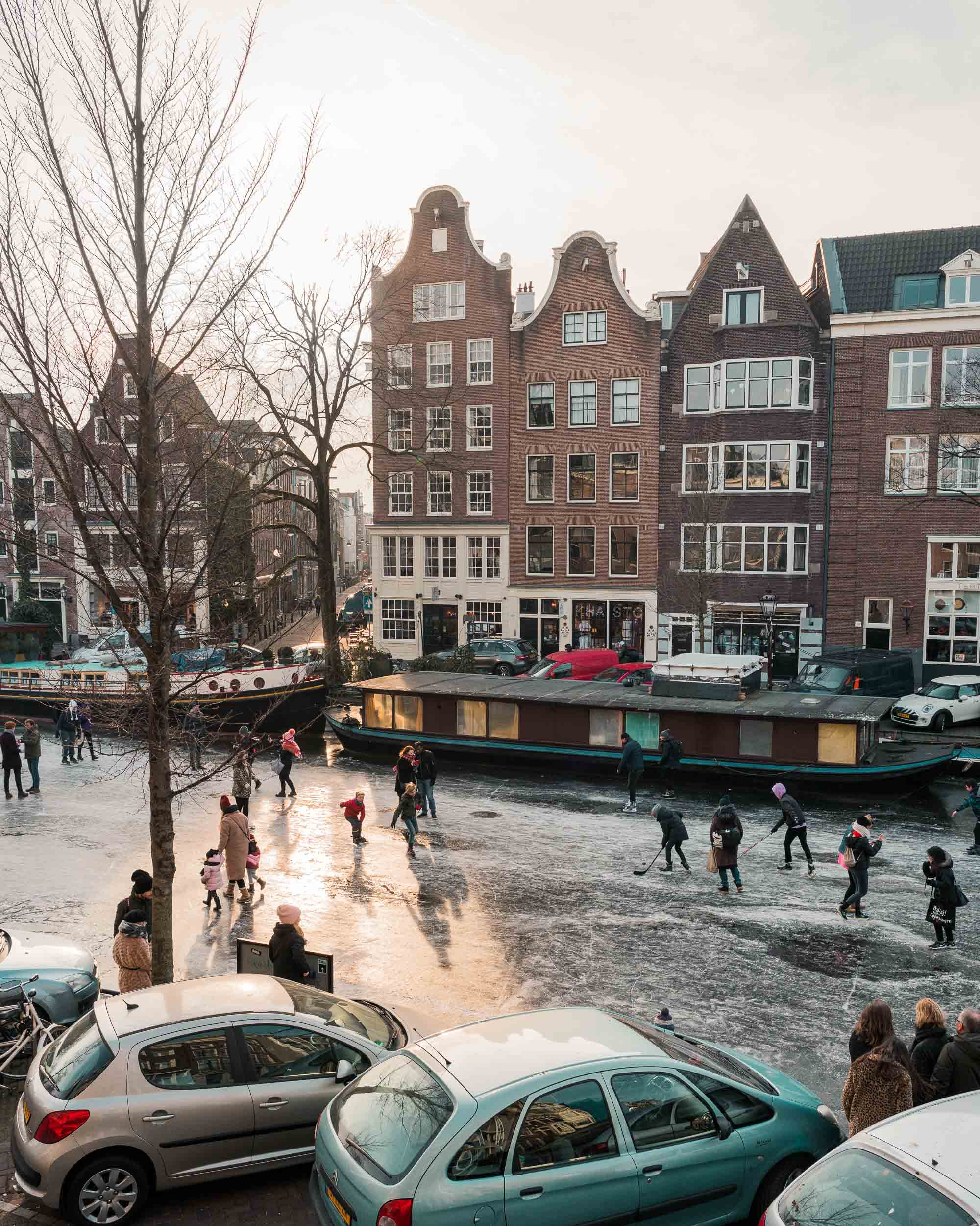 Ice skaters on the frozen canals in Amsterdam The Netherlands