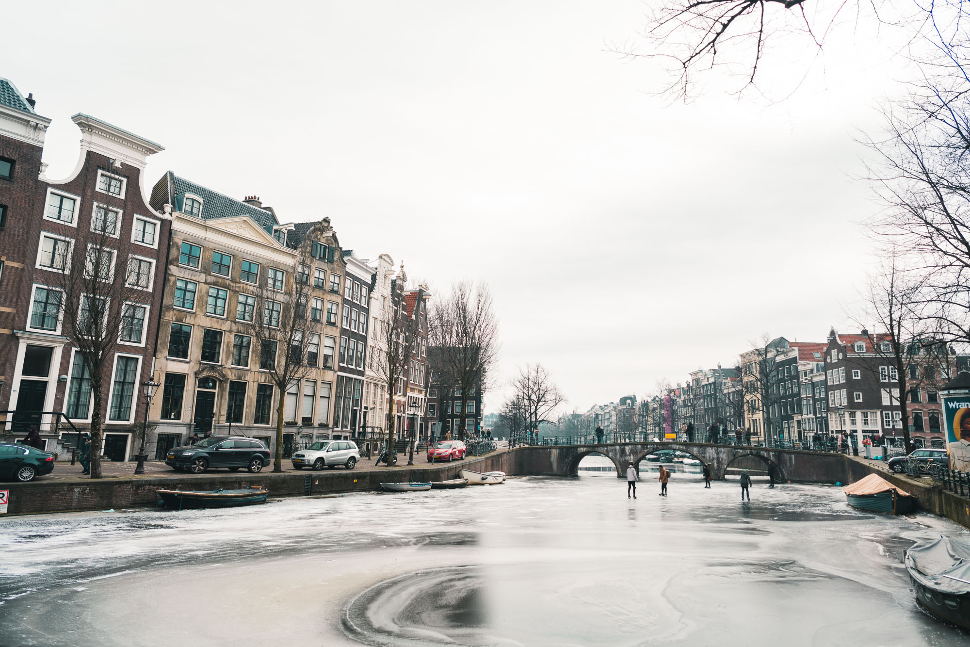 Frozen canals in winter at sunset in Amsterdam The Netherlands