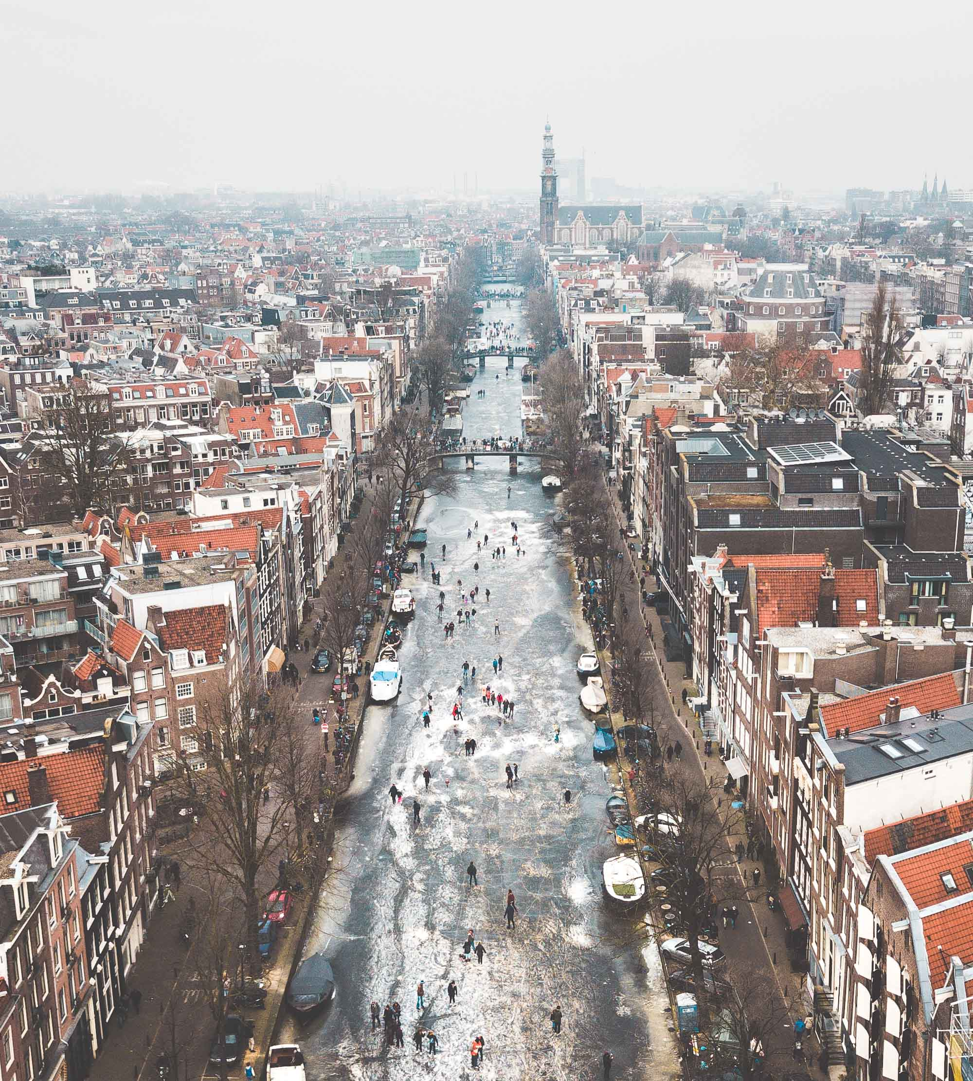 Overhead view of ice skaters on the frozen canals in Amsterdam The Netherlands