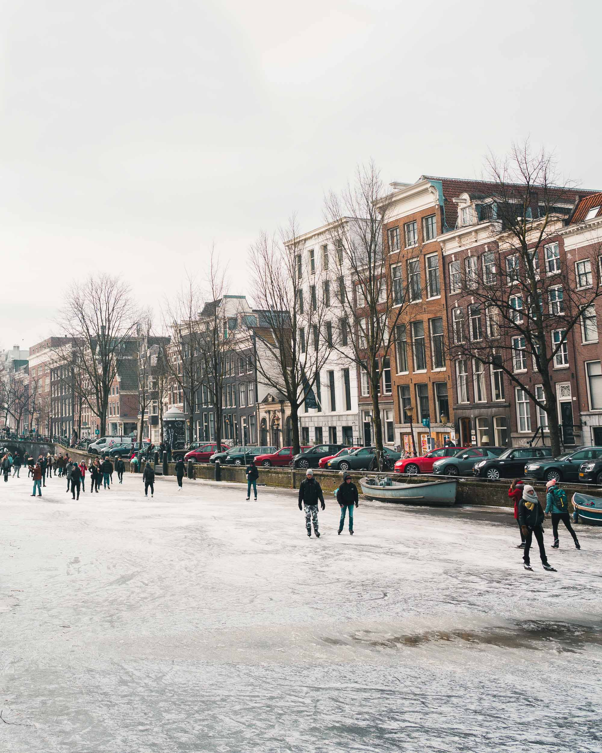 Ice skating on the frozen canals in Amsterdam The Netherlands