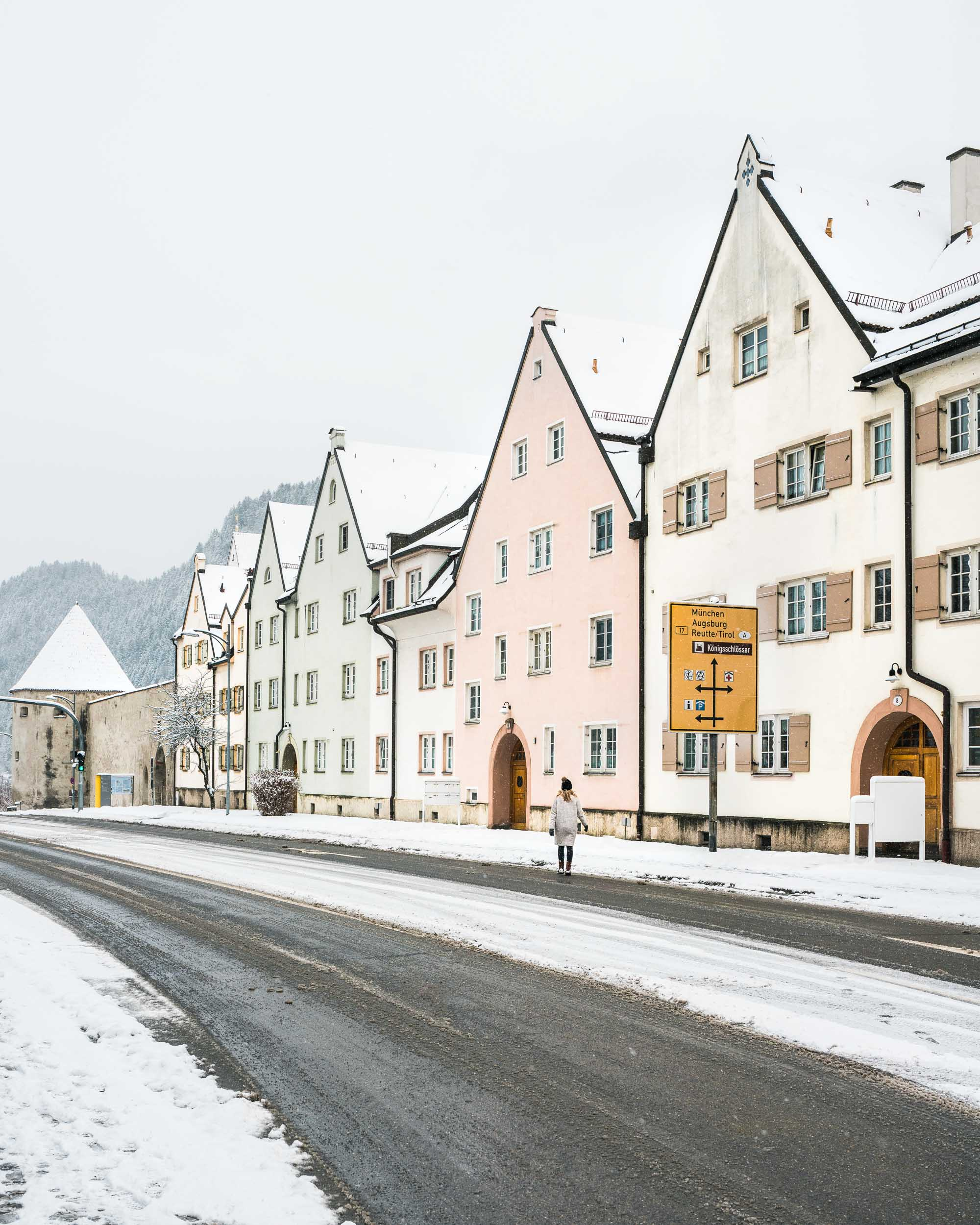 Travel blogger Selena Taylor in the pastel town of Fussen near Neuschwanstein Castle in Germany