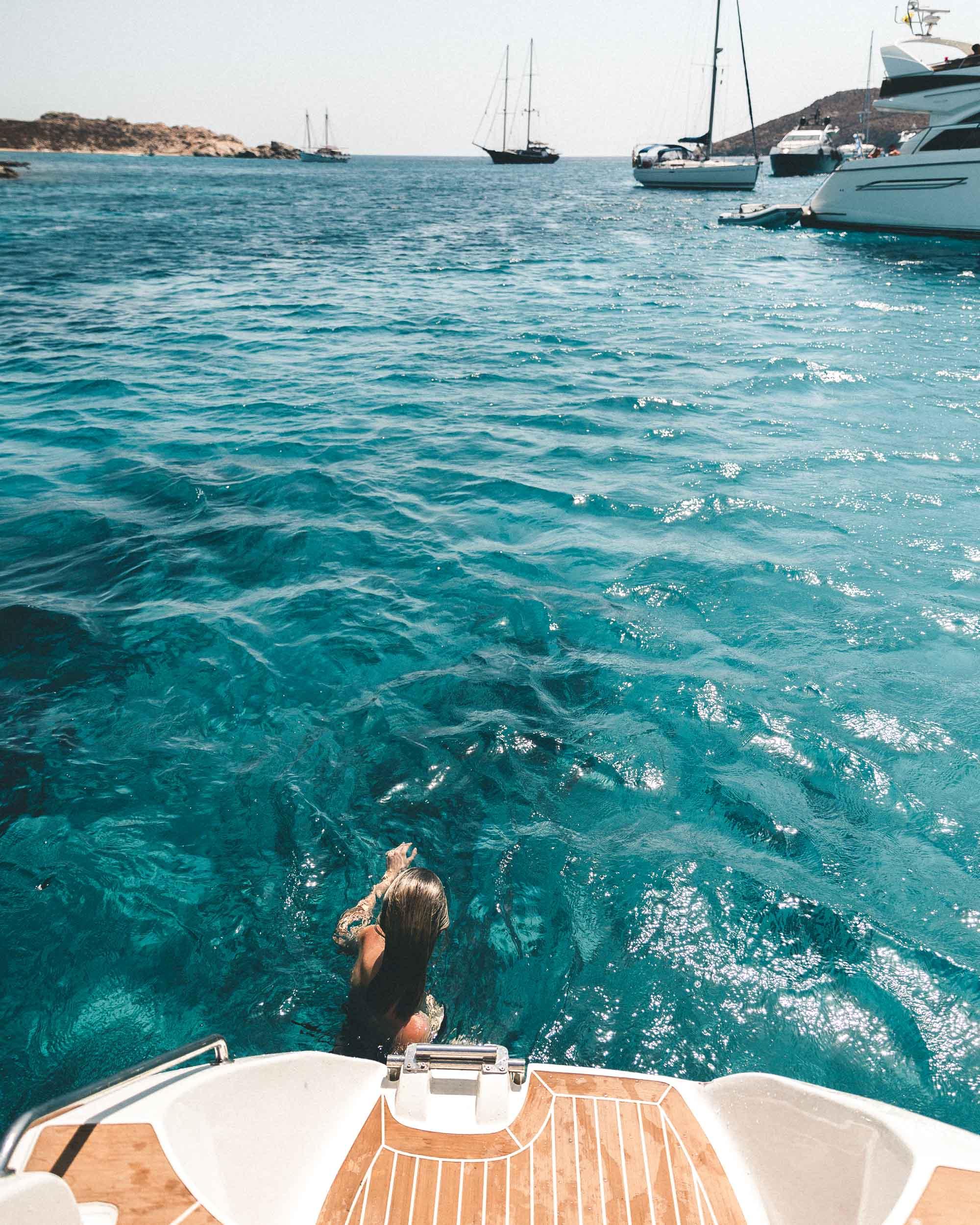 Swimming in the clear blue water in the mediterranean sea mykonos in the greek islands