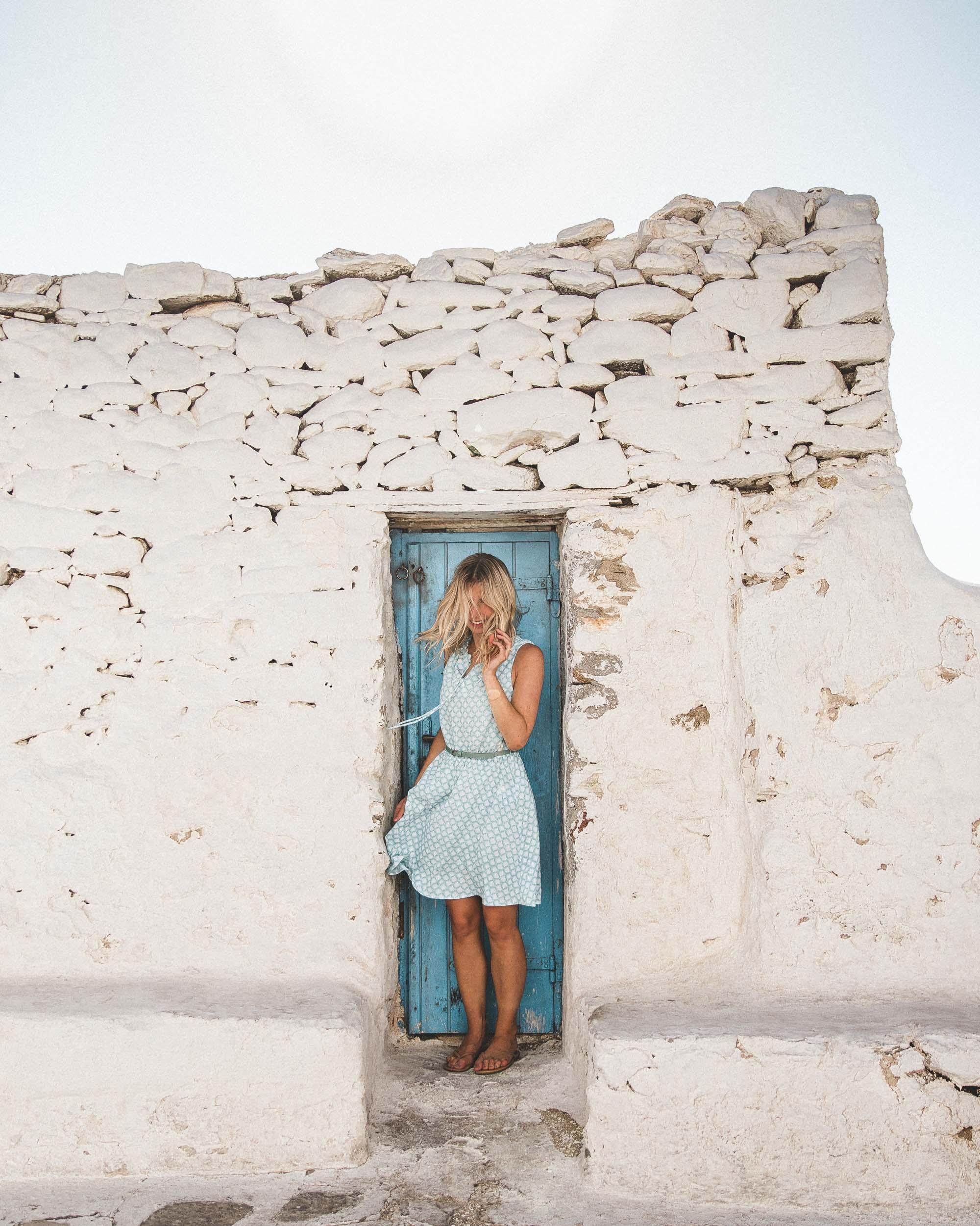 Downtown mykonos cobblestone streets white houses blue doors greek islands greece