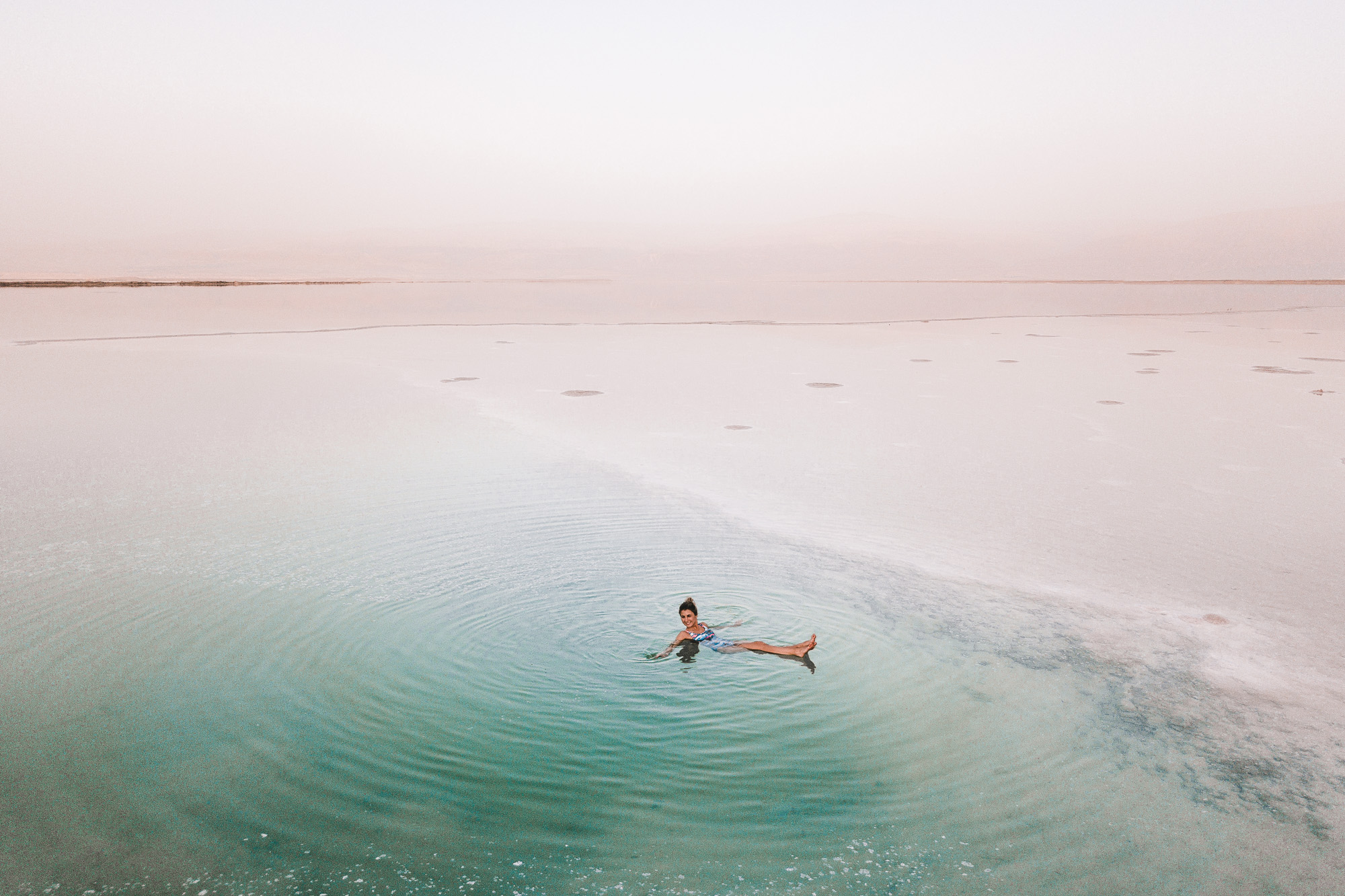Floating in the dead sea during dusk israel find us lost