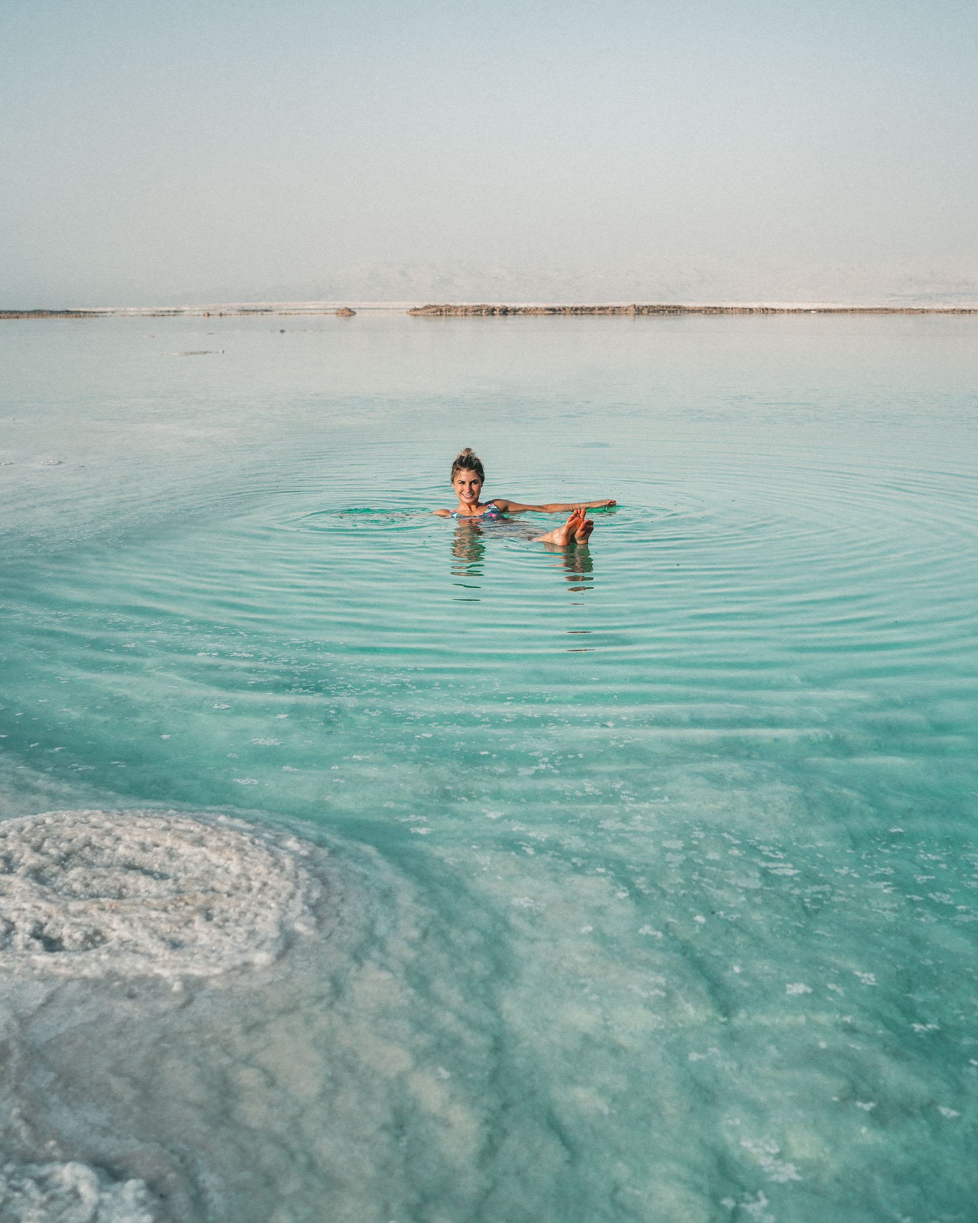 Floating in the Dead Sea in Israel Selena Taylor Travel blogger of Find Us Lost