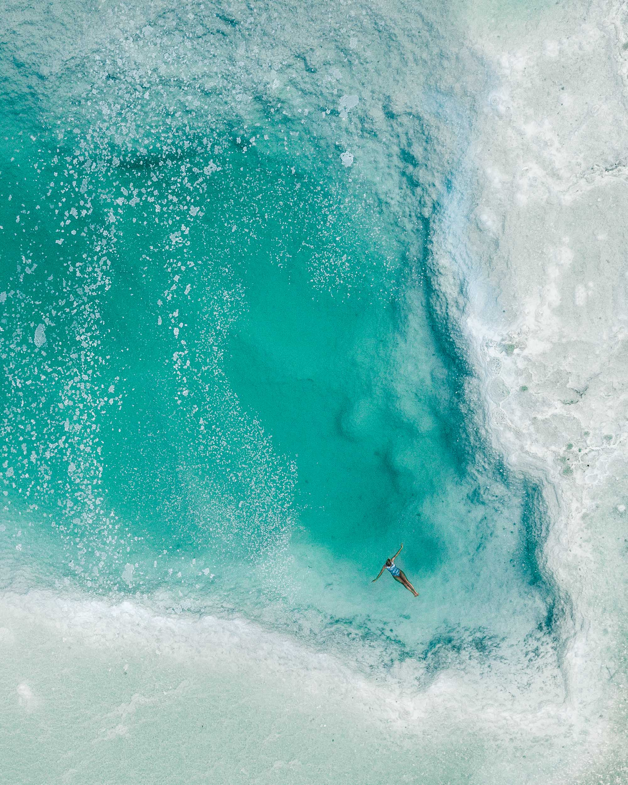 Floating in the dead sea overhead view by drone in Israel