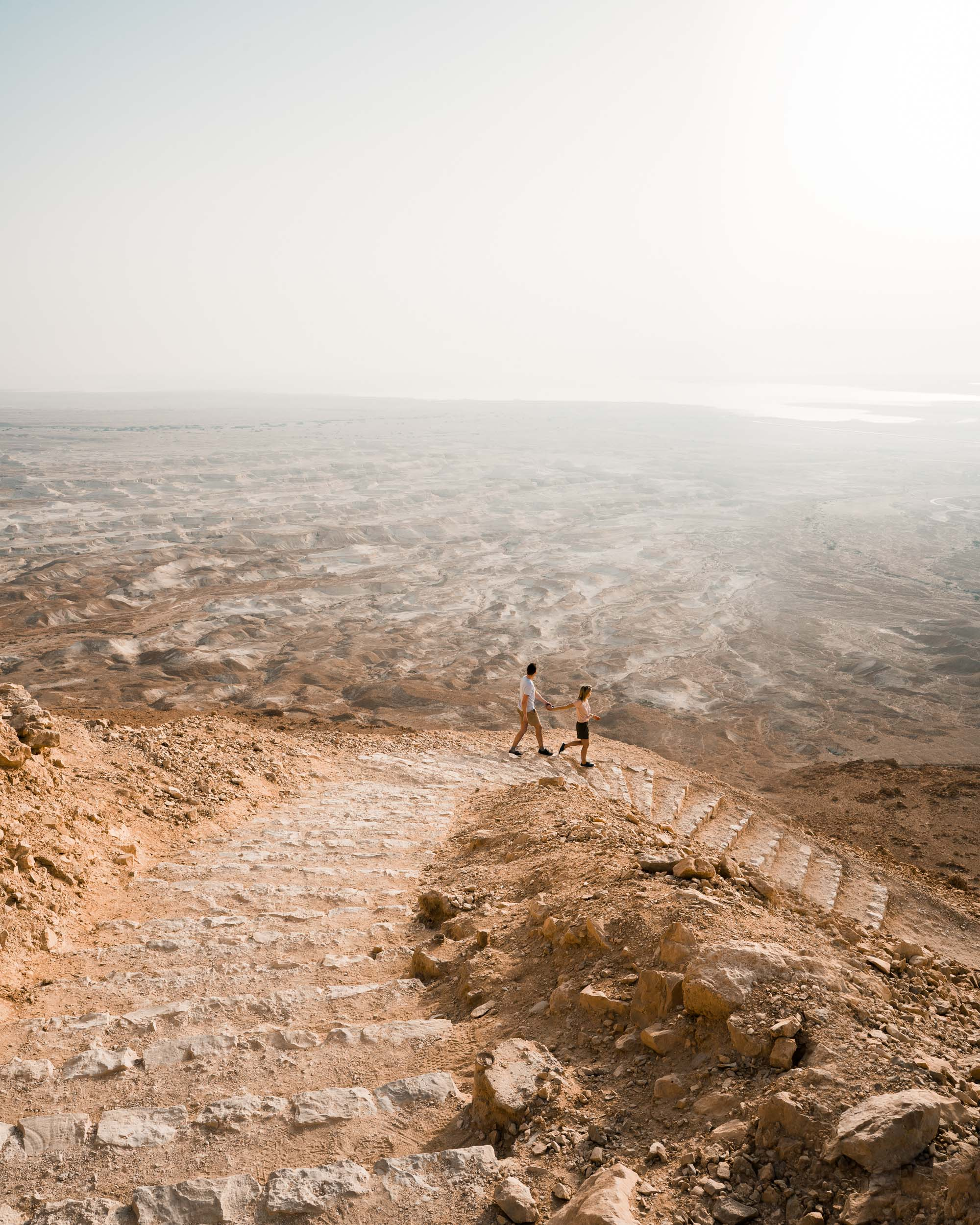 Sunrise over Masada hiking up stairs in the dead sea in Israel