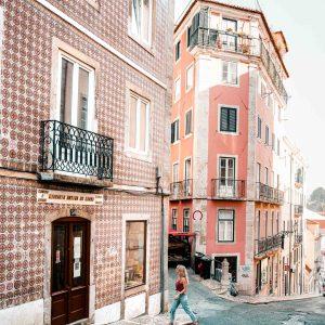 Travel blogger Selena Taylor exploring the colorful tiled houses of Lisbon, Portugal   Lisbon Travel Guide via Find Us Lost