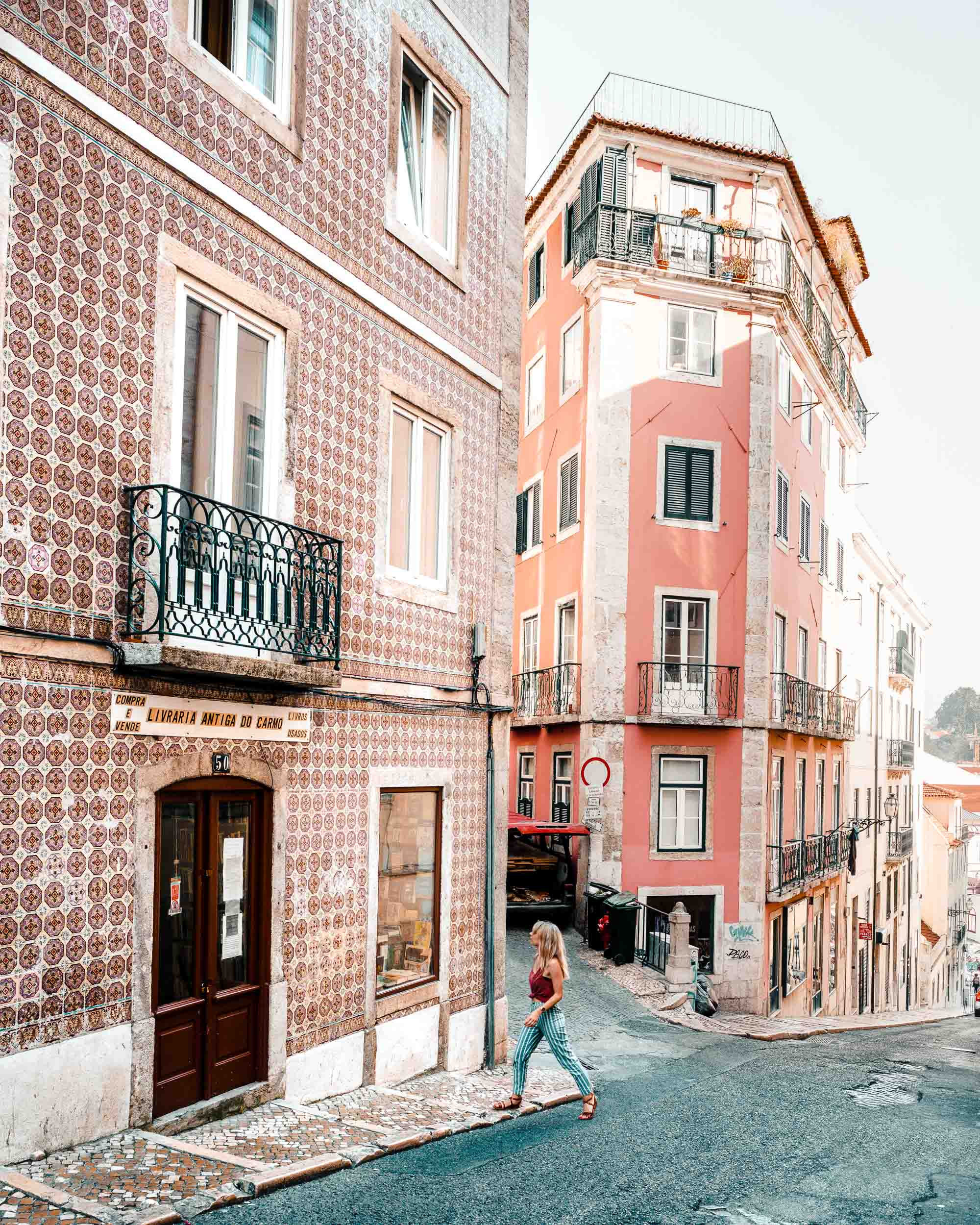 Travel blogger Selena Taylor exploring the colorful tiled houses of Lisbon, Portugal | Lisbon Travel Guide via Find Us Lost