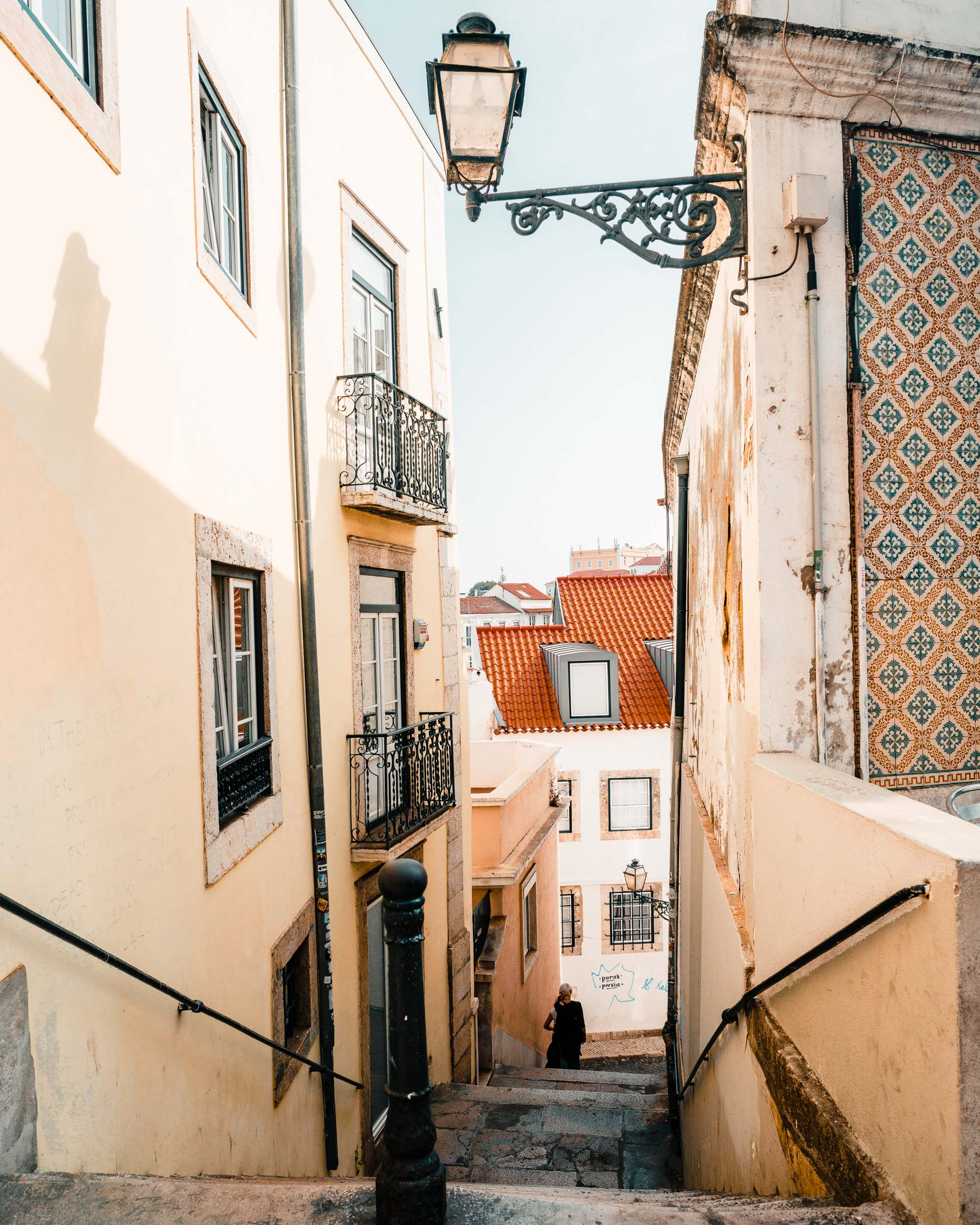 Tiled buildings and old walking streets in Alfama, Lisbon, Portugal | Lisbon Travel Guide via Find Us Lost