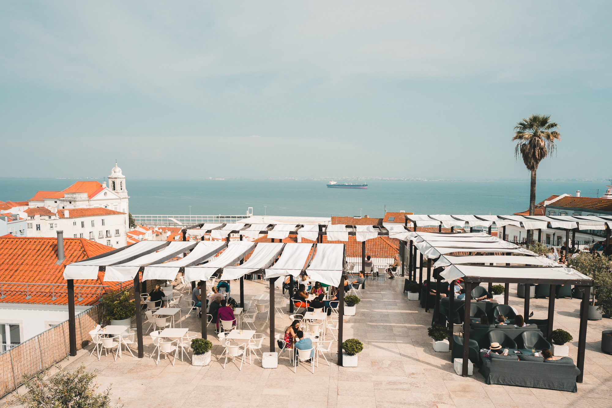 Lookout point in Alfama for the rooftops of Lisbon and sunset drinks in Portugal | Lisbon Travel Guide via Find Us Lost