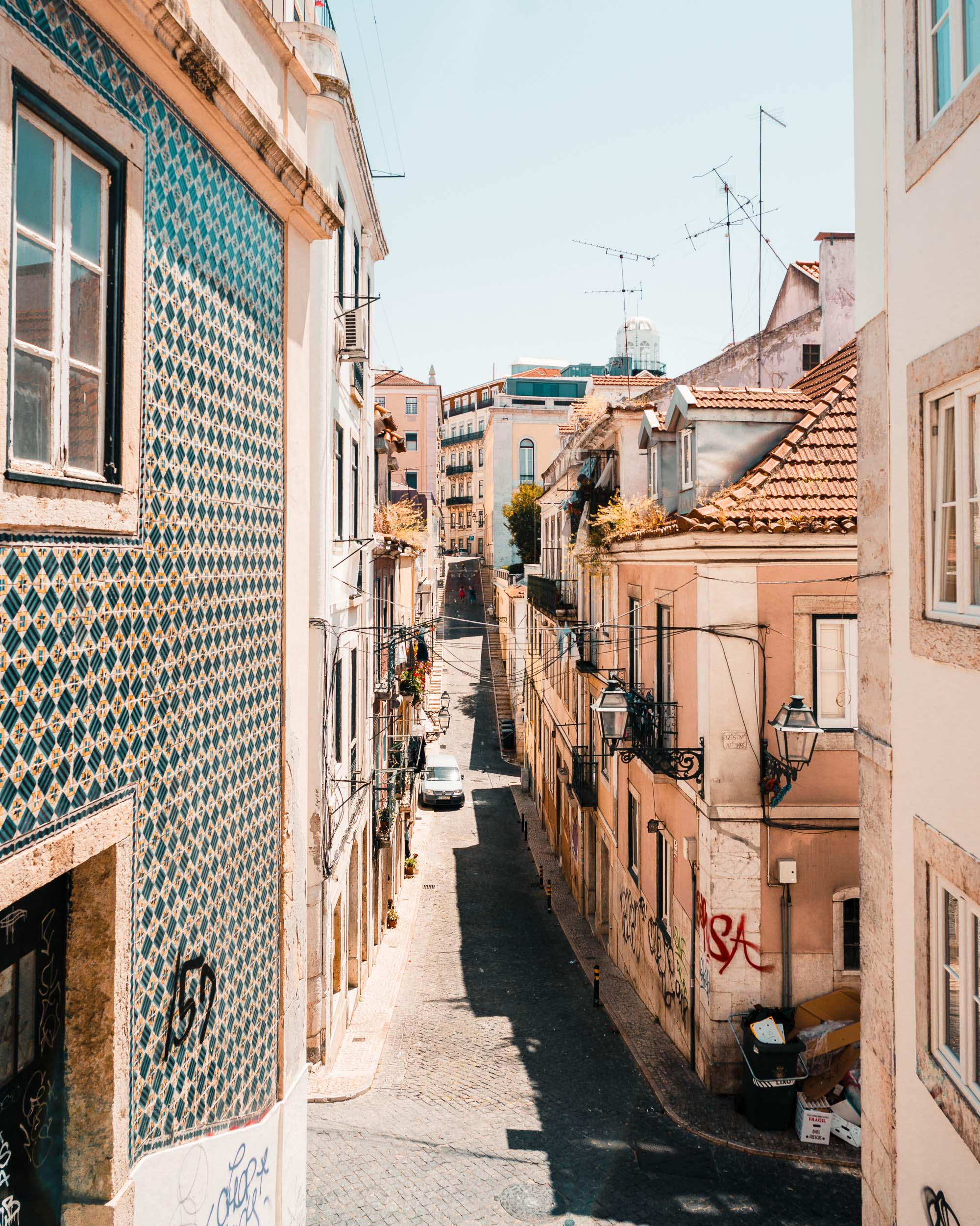 Colorful tiled buildings near Barrio Alto in Lisbon, Portugal | Lisbon Travel Guide via Find Us Lost