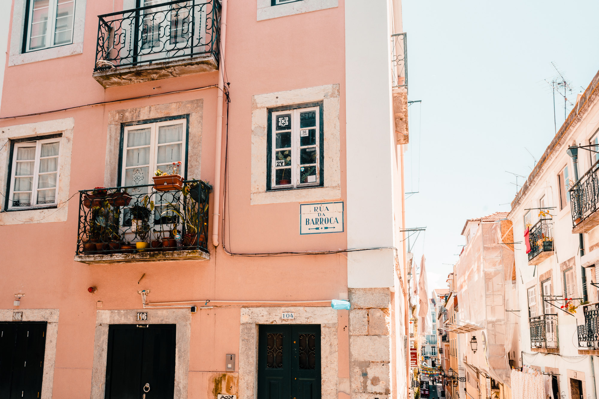 Pink buildings and colorful streets in Lisbon, Portugal | Lisbon Travel Guide via Find Us Lost