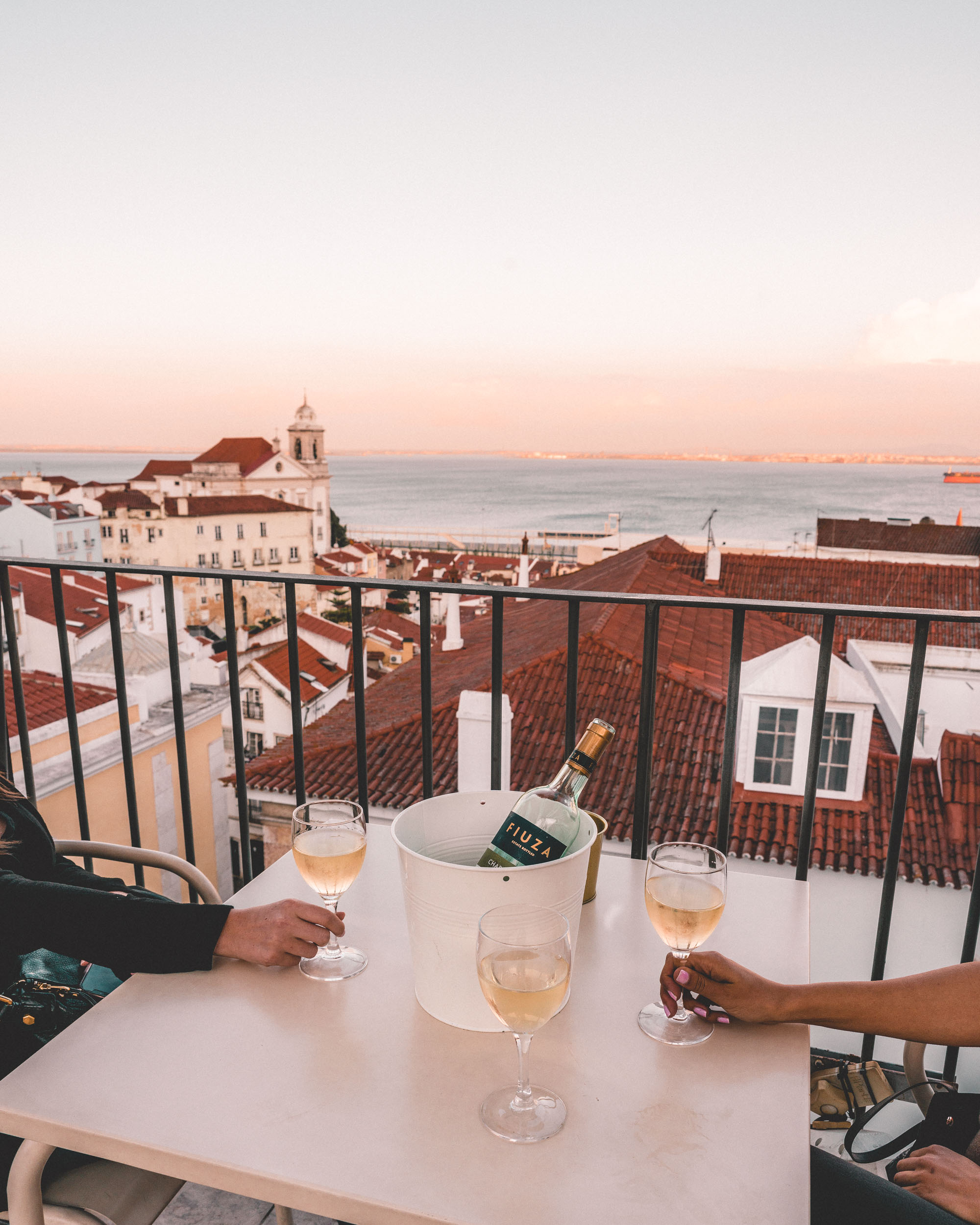 One of the best rooftop lookouts in Lisbon at Portas do Sol in the Alfama district of Portugal | Lisbon Travel Guide via Find Us Lost