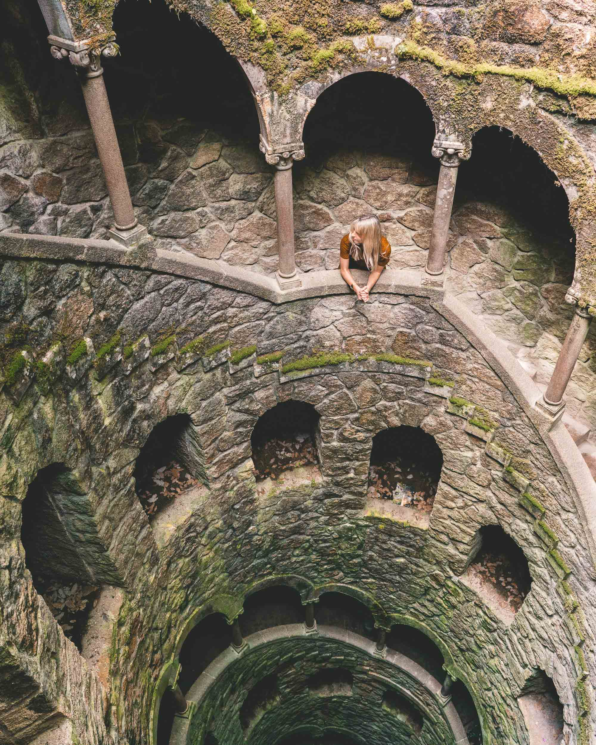 Looking down the initiation well at Quinta de Regulaira in Sintra, Portugal where castles are | Lisbon Travel Guide via Find Us Lost