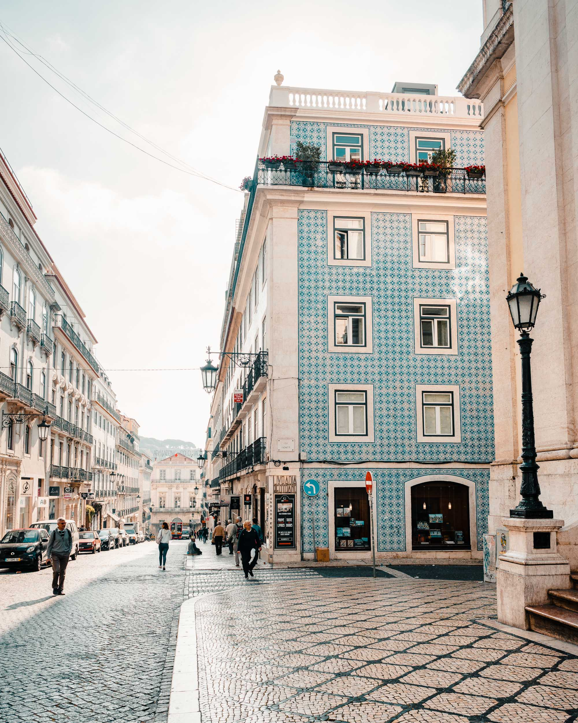Blue tiled buildings and walking streets in Lisbon, Portugal | Lisbon Travel Guide via Find Us Lost