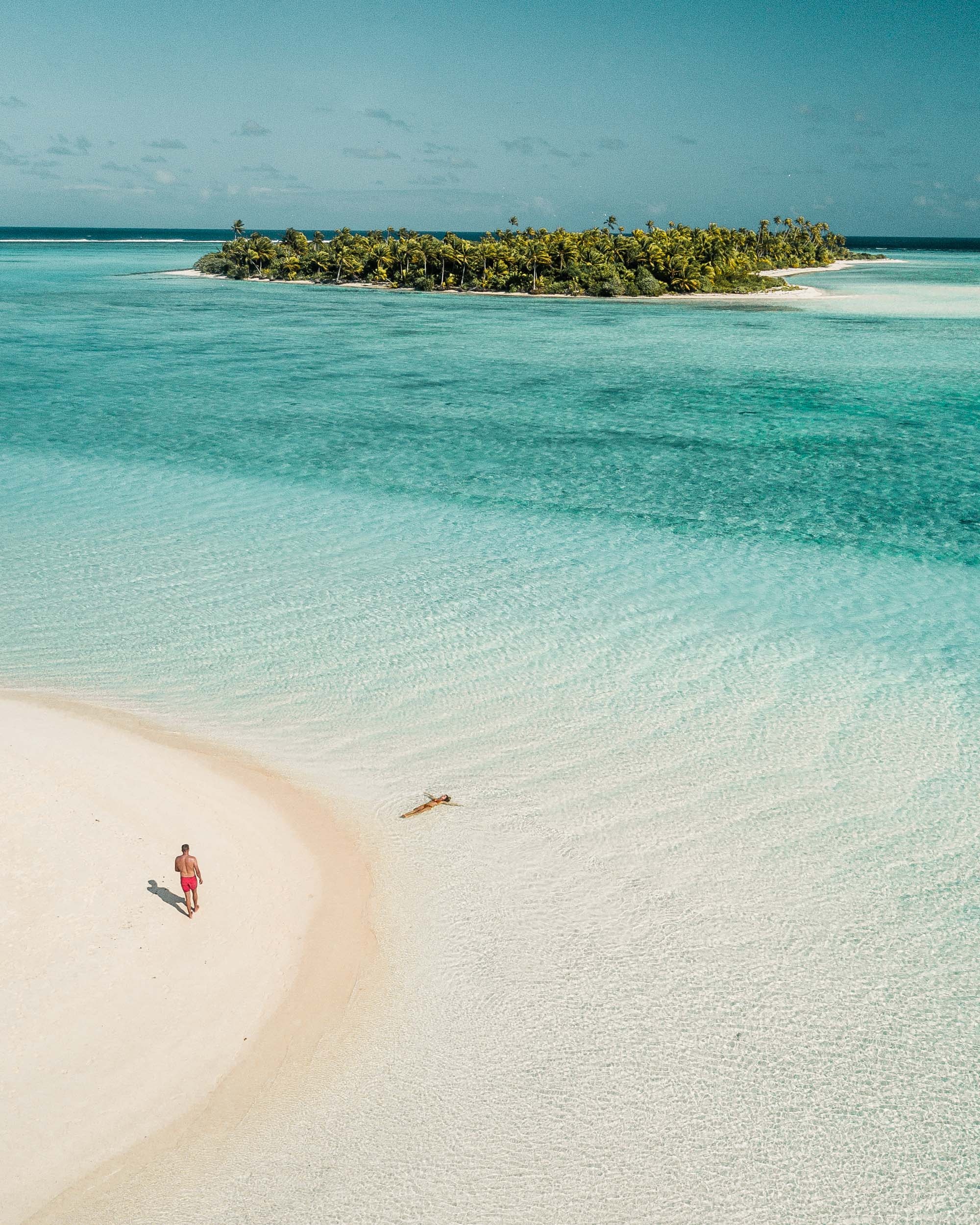 Couple travel bloggers Selena and Jacob Taylor at Honeymoon Island in the Cook Islands