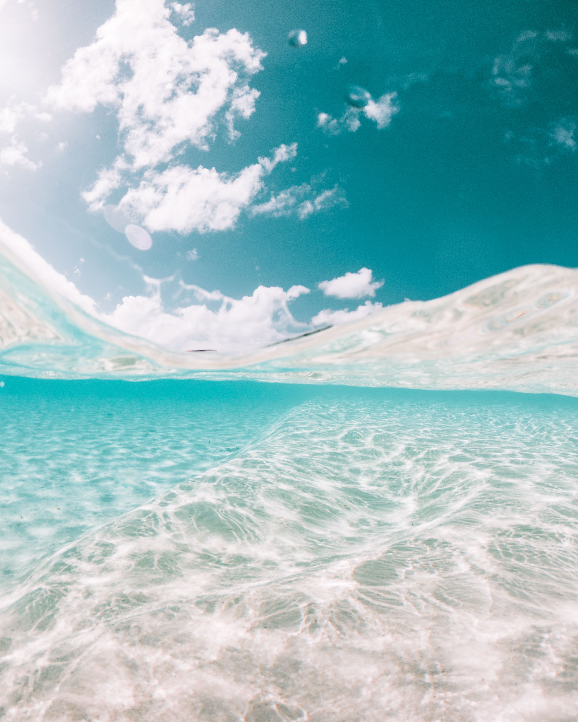 Underwater shot of clear blue turquoise water in the Cook Islands