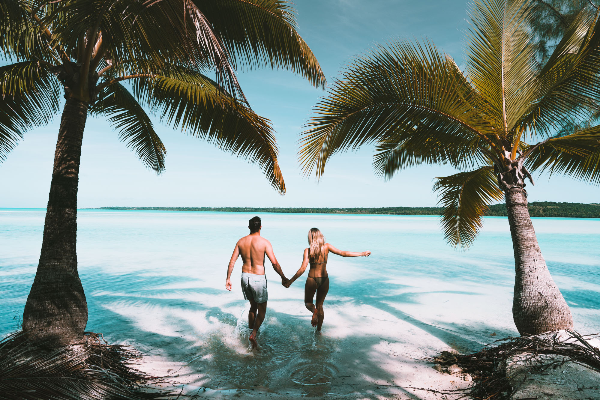 Couple travel bloggers Selena and Jacob Taylor in Aitutaki, Cook Islands