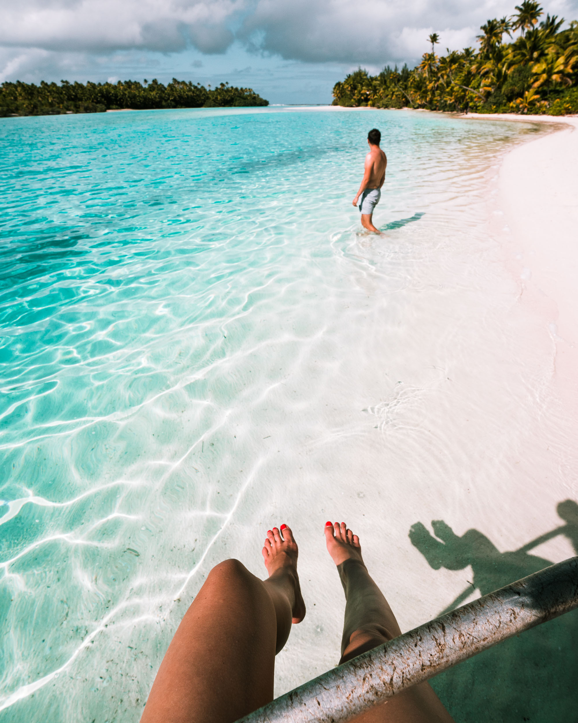 Couple travel bloggers Selena and Jacob Taylor of Find Us Lost at One Foot Island in the Cook Islands