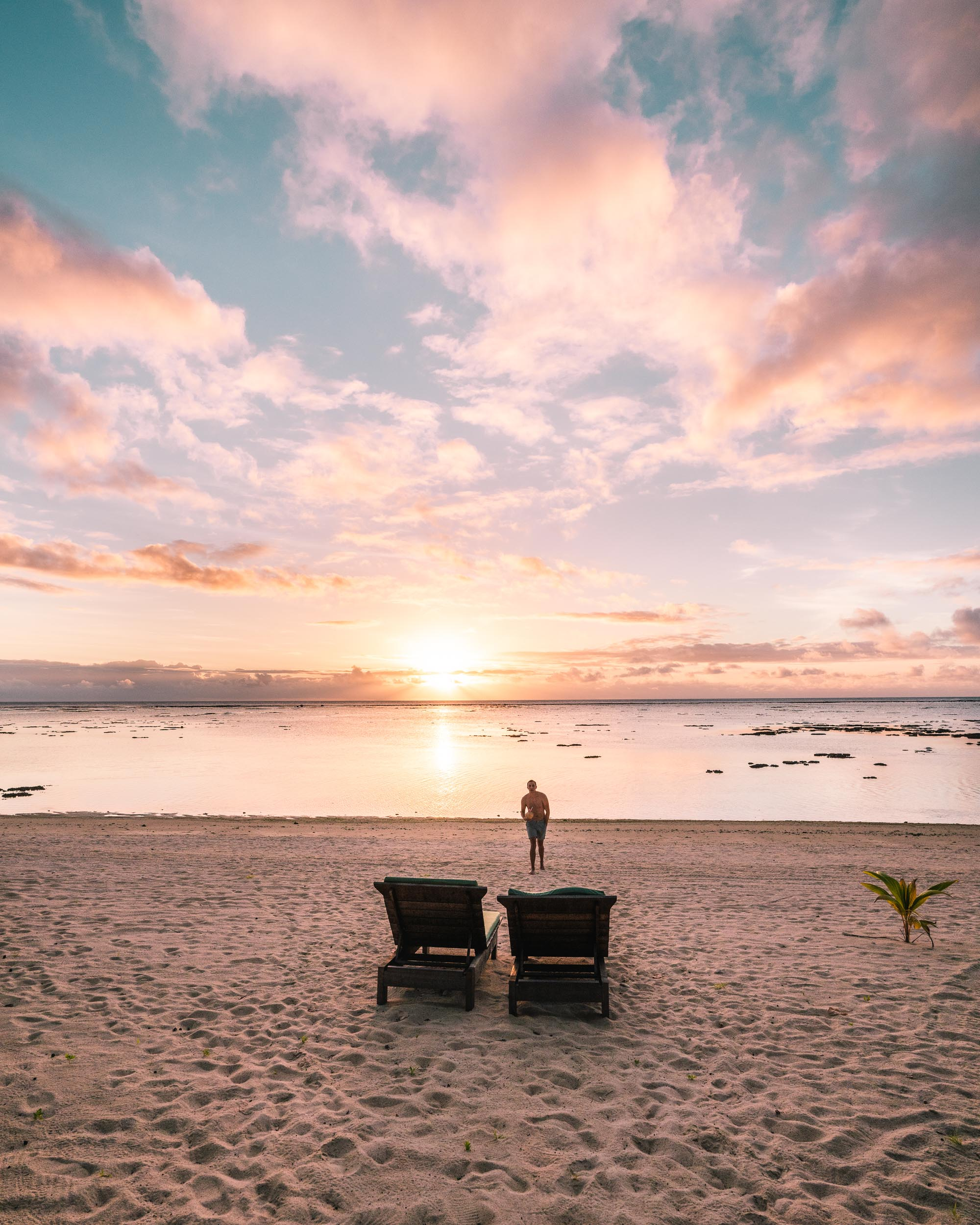Sunset views from our jungle bungalow at Pacific Resort Aitutaki, Cook Islands