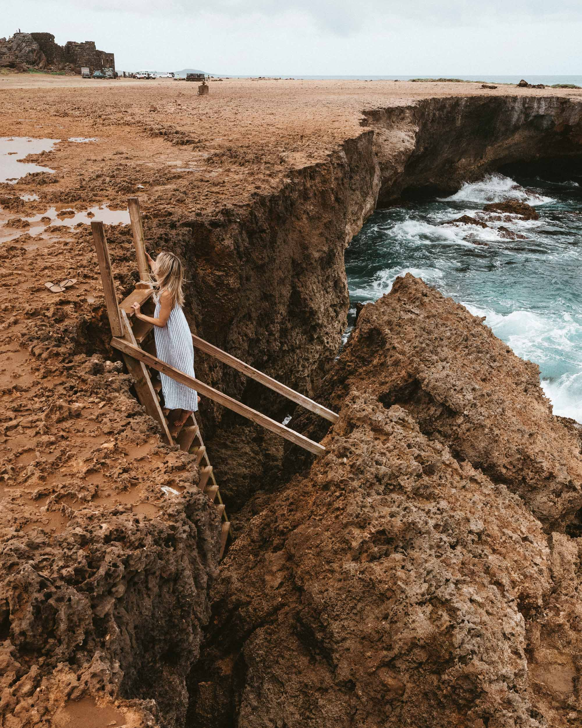 Ladder to a natural swimming hole in Aruba via Find Us Lost