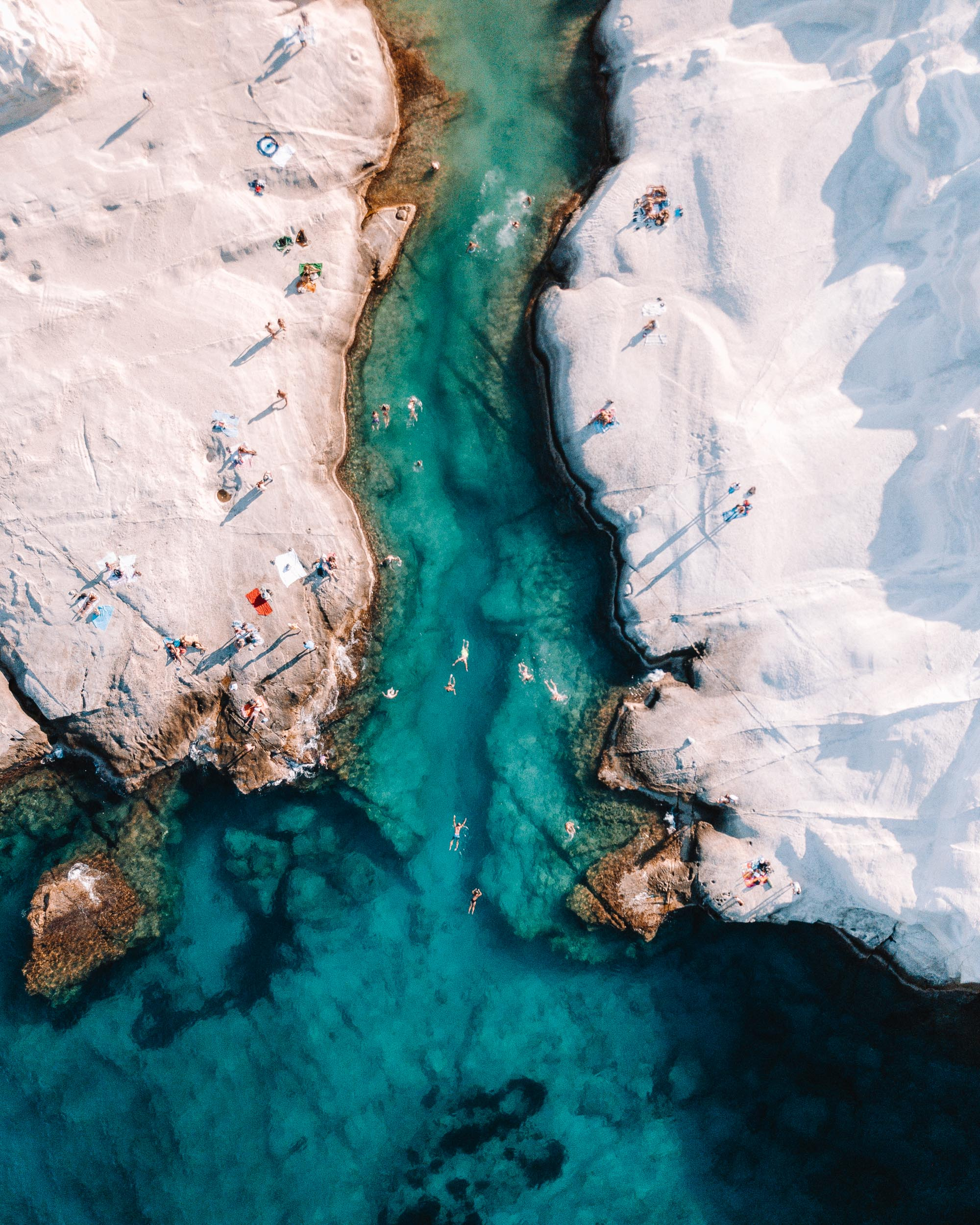Drone shot of Sarakiniko white beach in Milos, Greek Islands via @finduslost