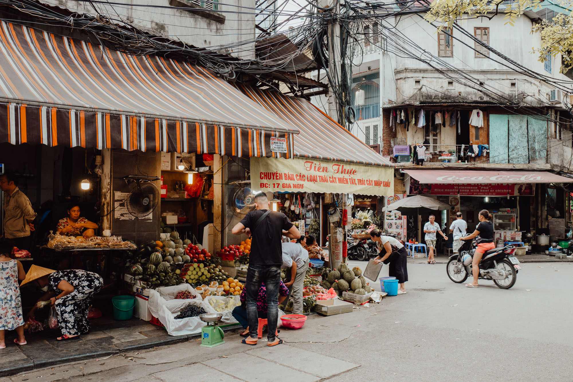 Streets and fruit shops in Hanoi Vietnam