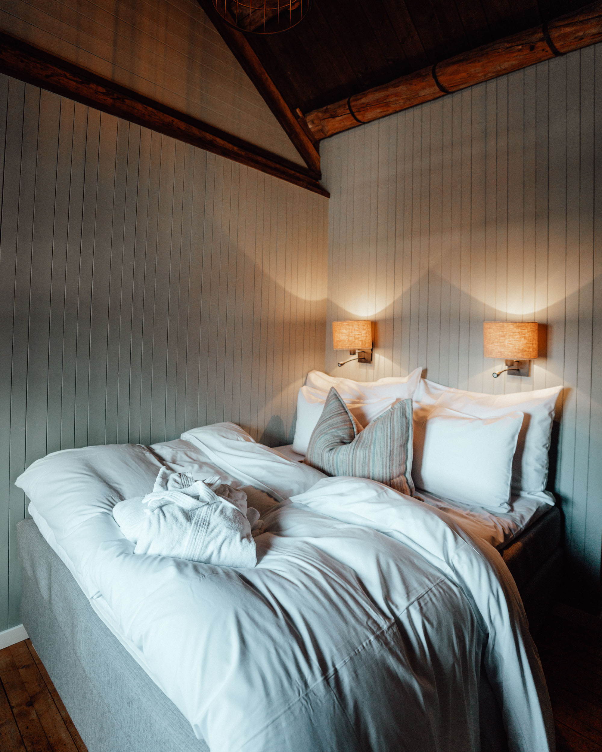 Bedroom of Hotel in Lofoten Norway Nusfjord Arctic Resort Traditional Fishermen Red Cabin with a Fjord View - Find Us Lost
