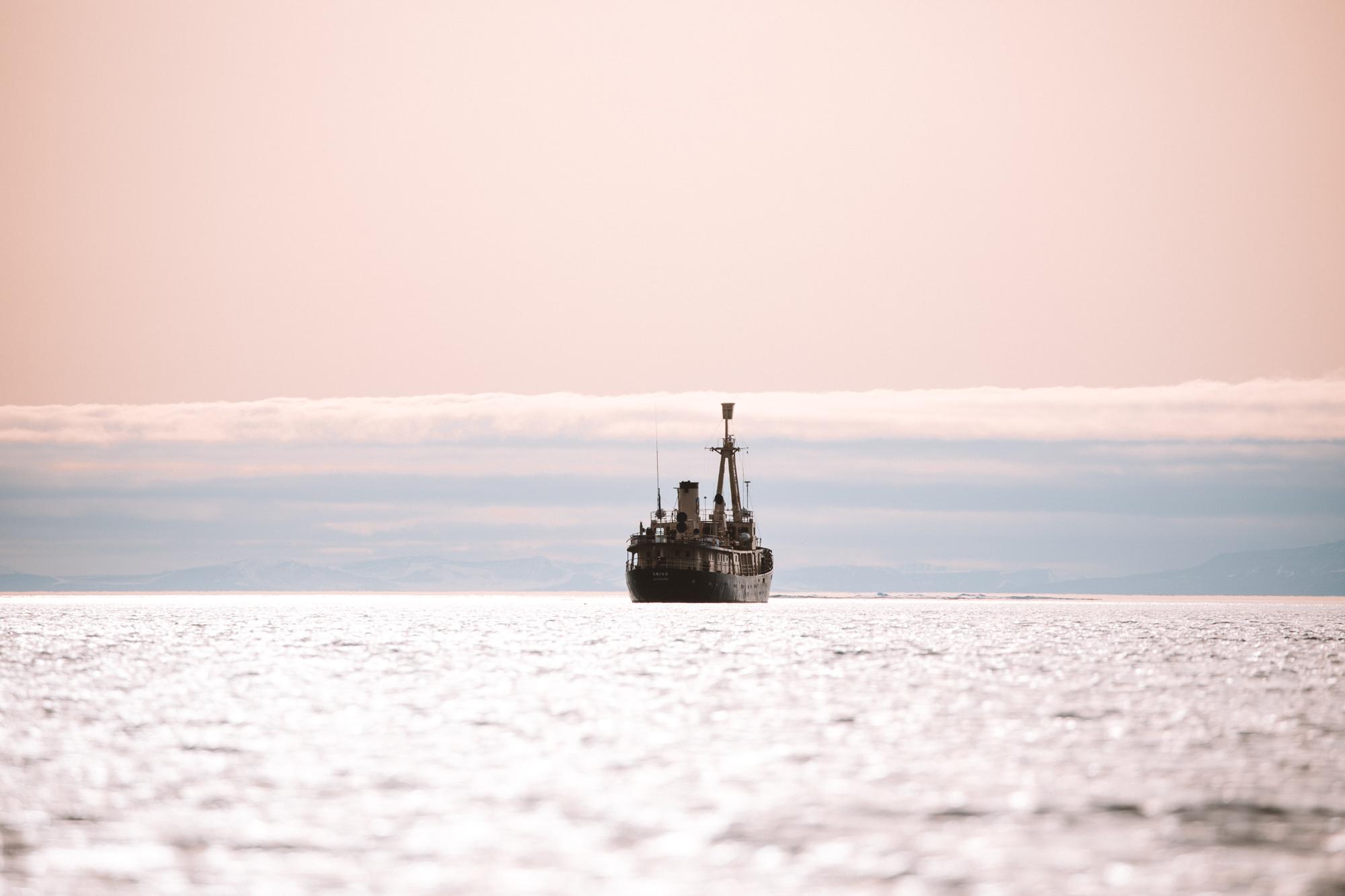 Ship in the midnight sun Spitsbergen, Svalbard, Norway