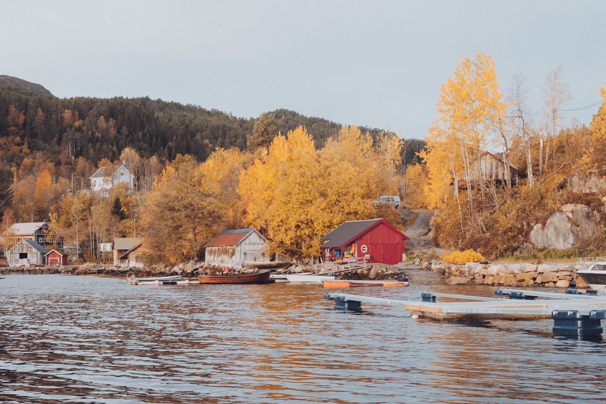 Fall in the Norwegian fjords from a boat in Alesund, Norway