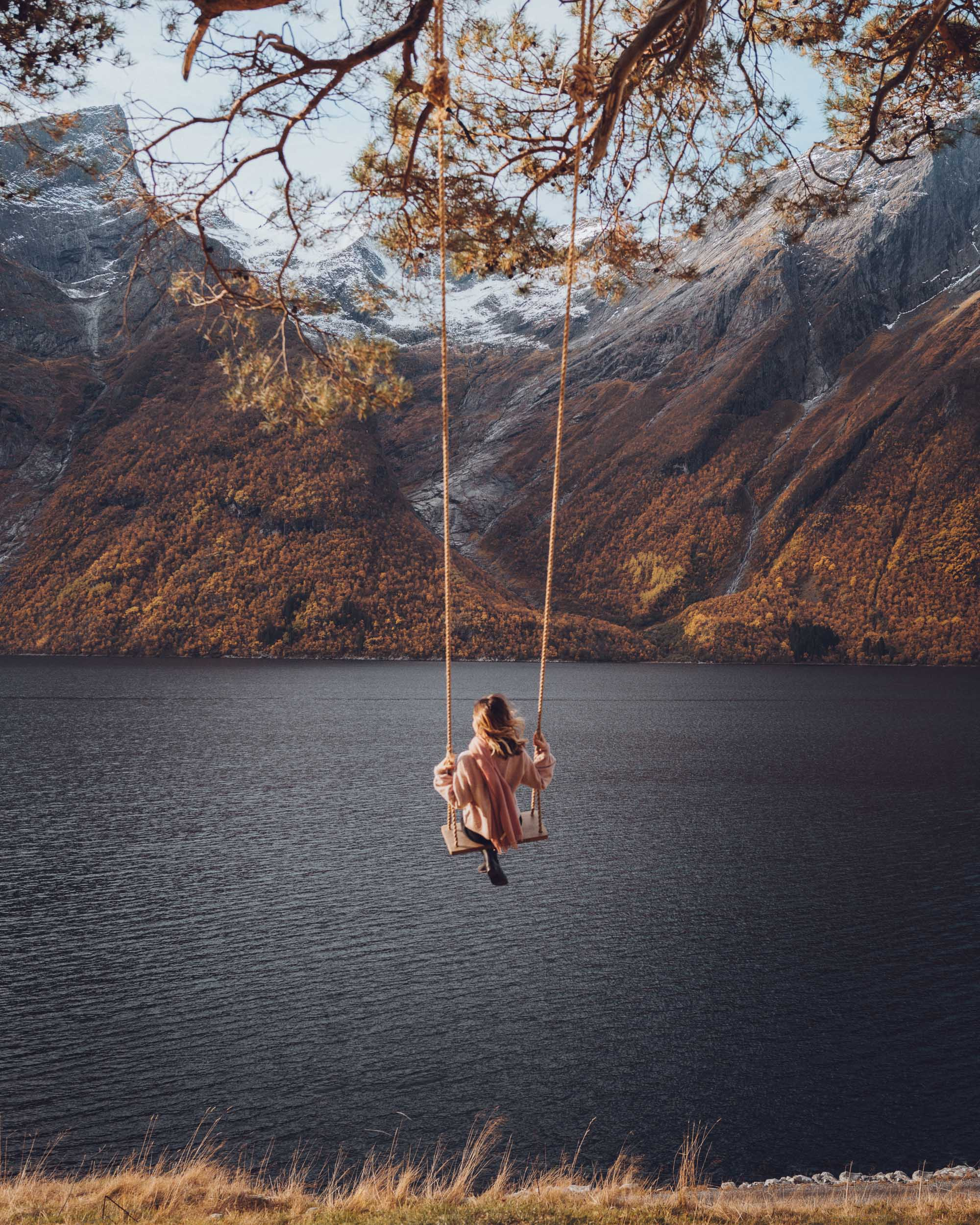 Swing in the Norwegian fjords in Trandal, Norway