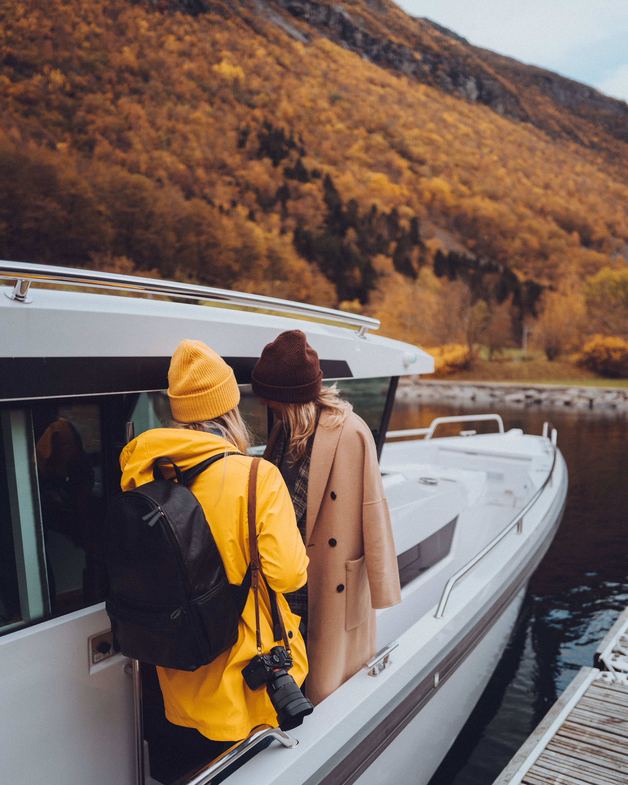 Fall boat ride through the Norwegian fjords in Alesund, Norway