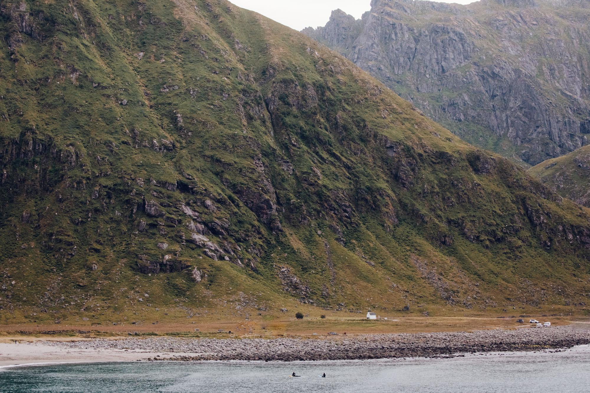 Haukland beach arctic surfers in Lofoten, Norway