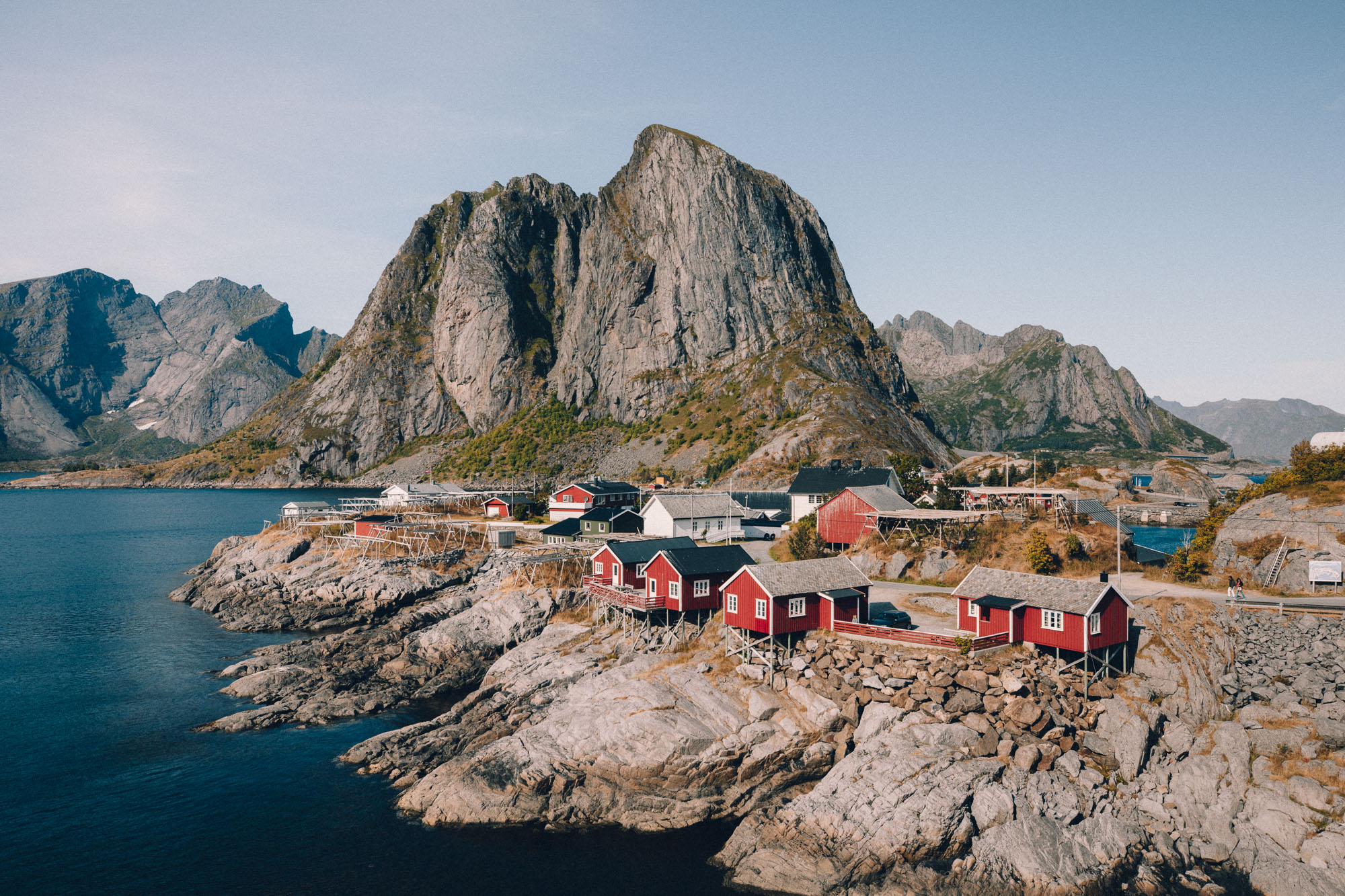 Famous viewpoint red houses on the water with rocks in Hamnoy, Lofoten, Norway