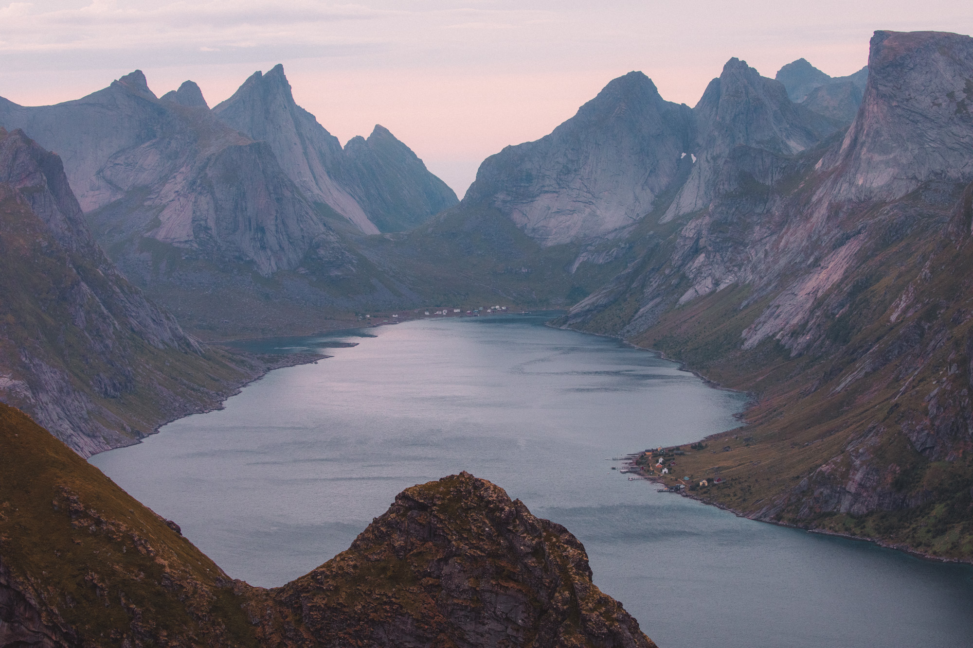 Sunset at the top of hike to Reinebringen in Lofoten Islands in Norway
