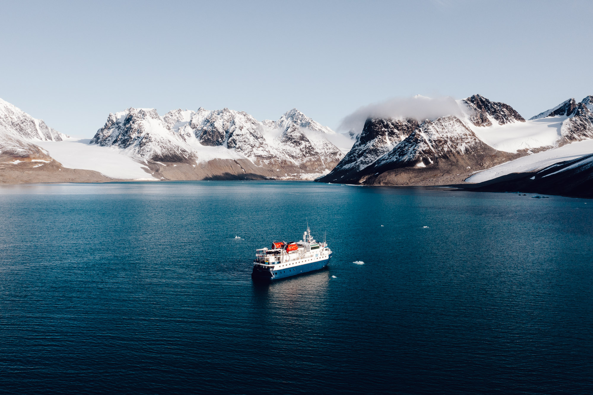 Magdalenefjorden with polarquest ship drone aerial photo in Spitsbergen Svalbard via Find Us Lost