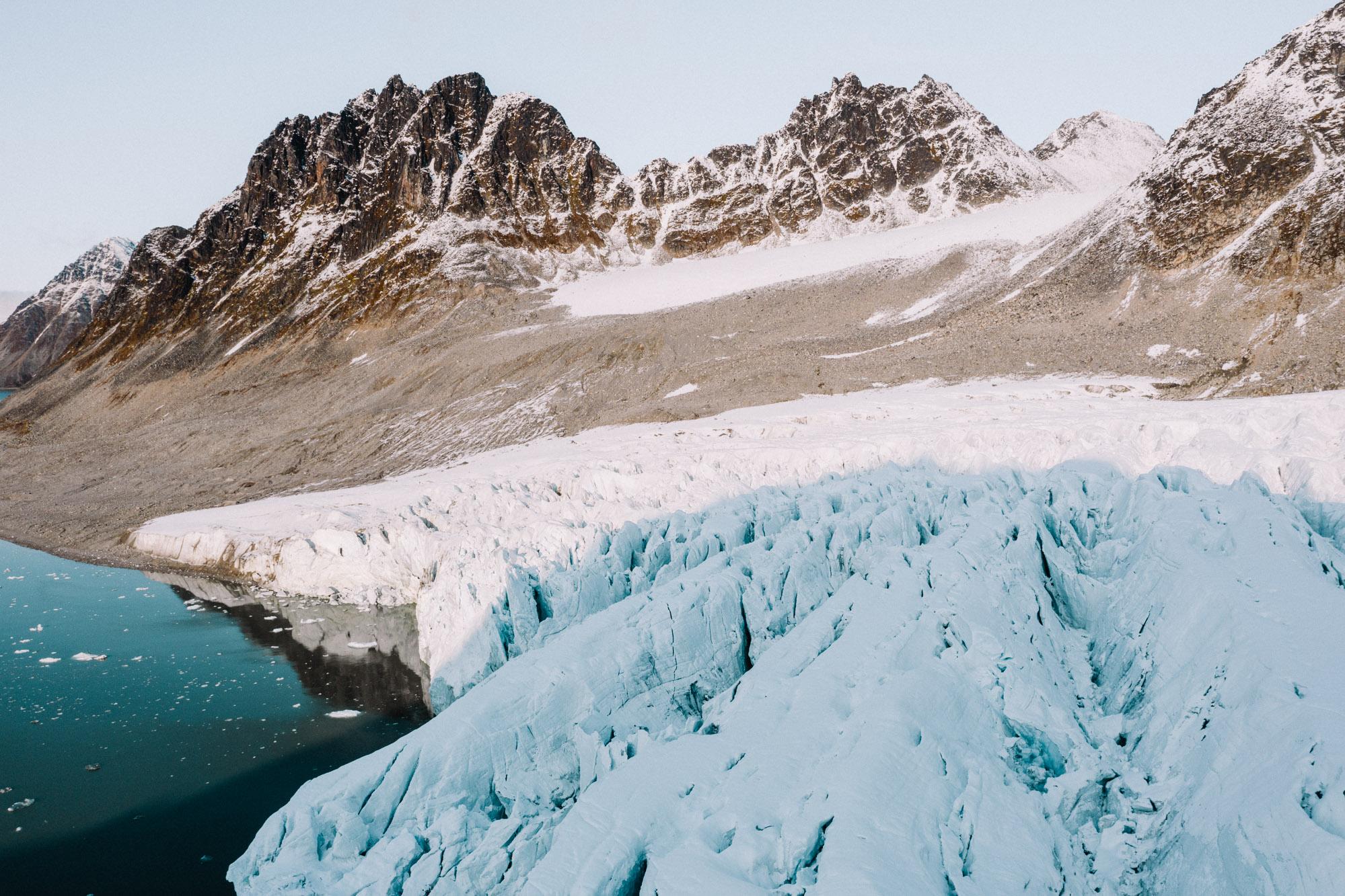 Drone aerial shot of Magdalenefjorden in Spitsbergen Svalbard via Find Us Lost