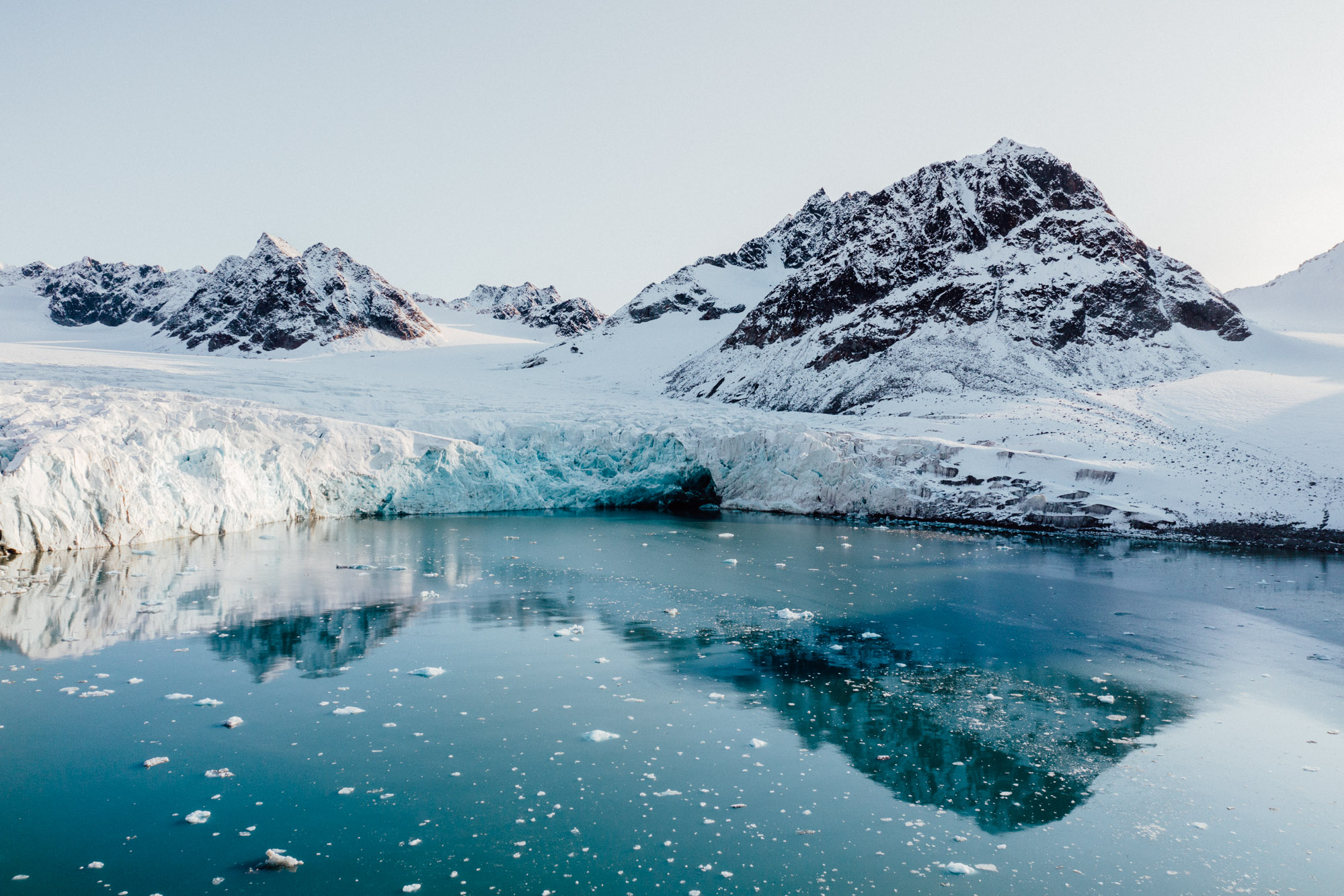 Aerial shot of Magdalenefjorden glacier from drone in Spitsbergen Svalbard via Find Us Lost
