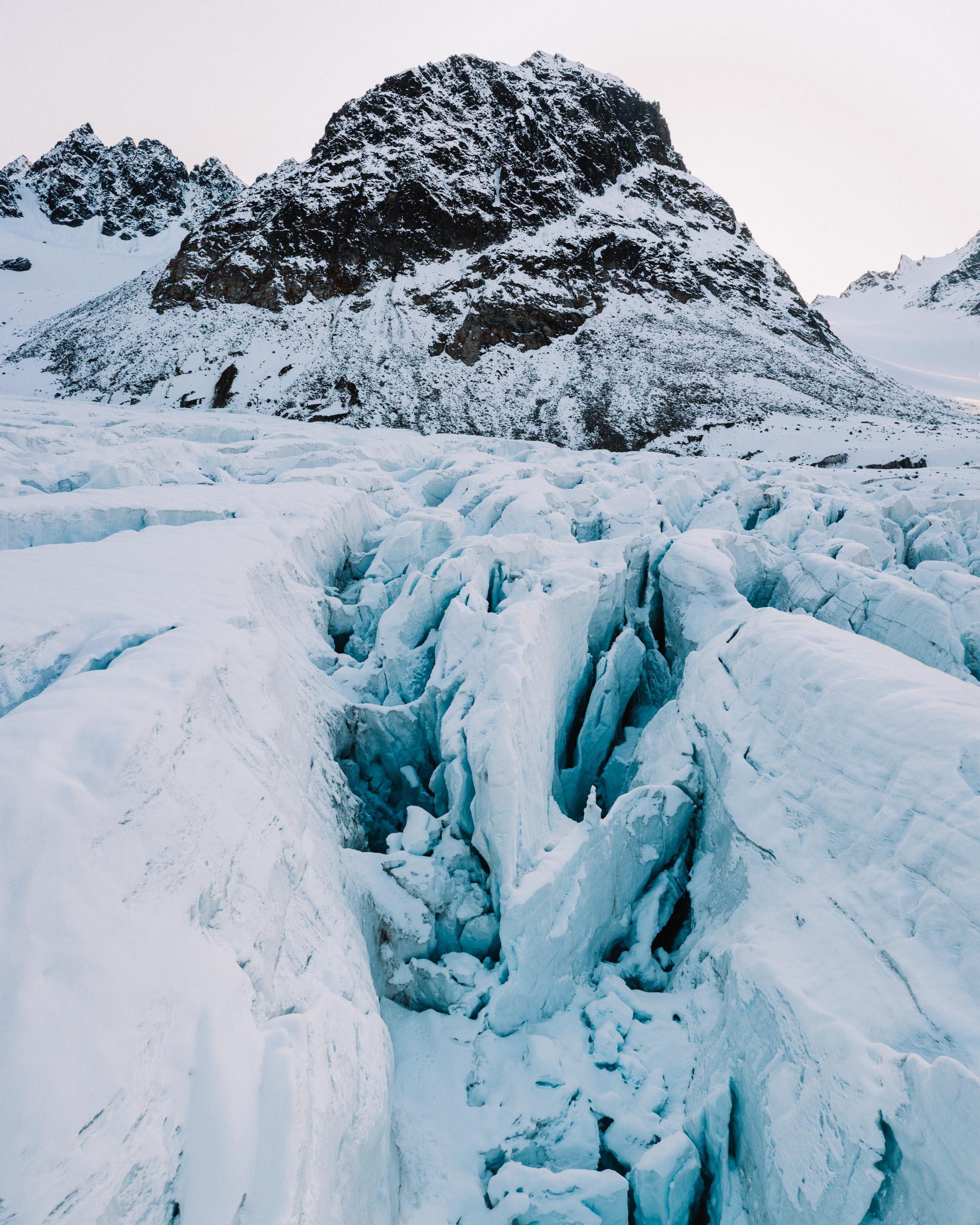 Drone aerial shot of Magdalenefjorden glacier in Spitsbergen Svalbard via Find Us Lost
