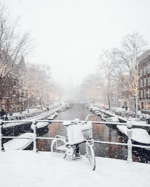 Amsterdam canal in the snow during winter in the Netherlands via @finduslost