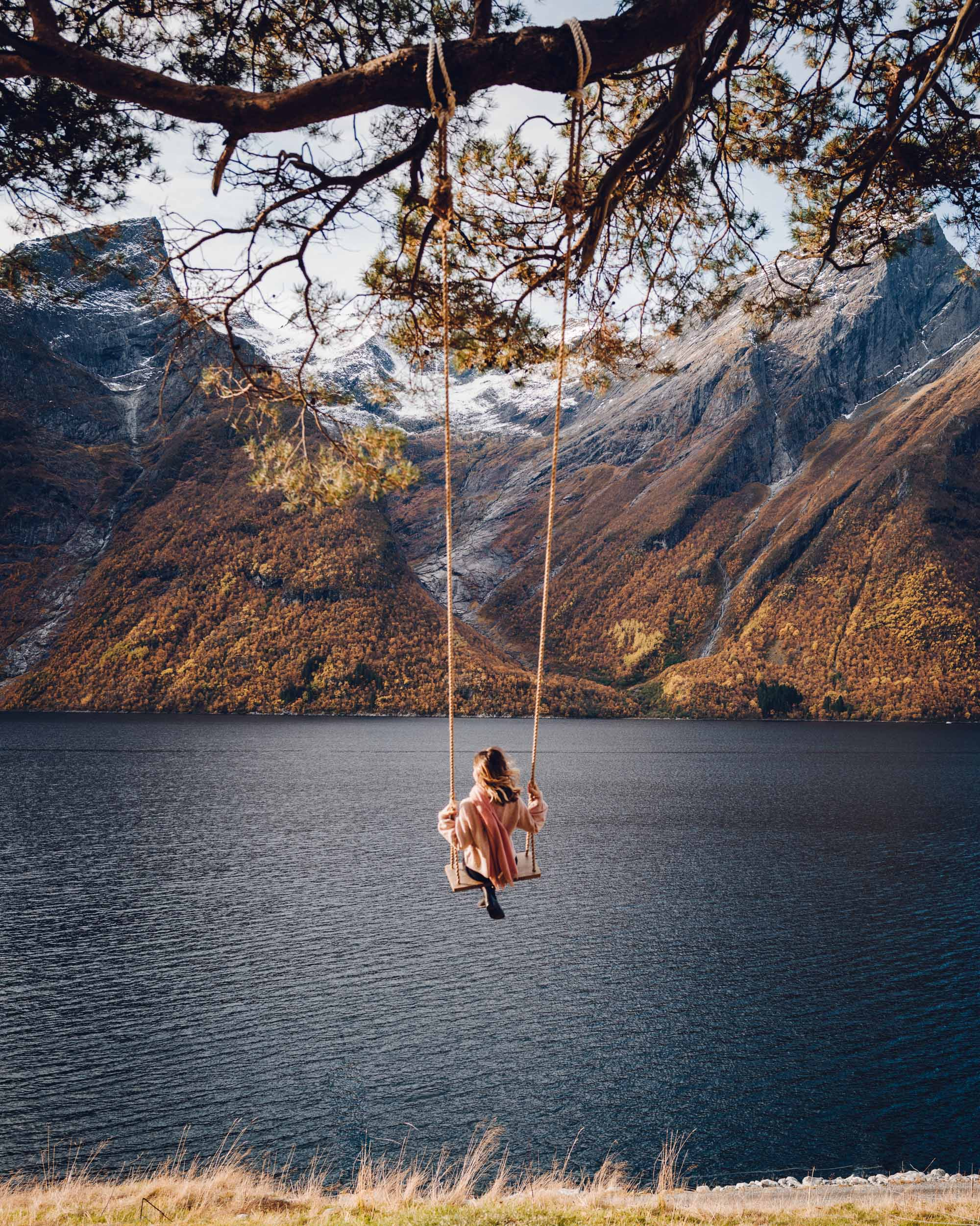 Swing in Alesund, Norway over the fjords and water edited with Find Us Lost Presets