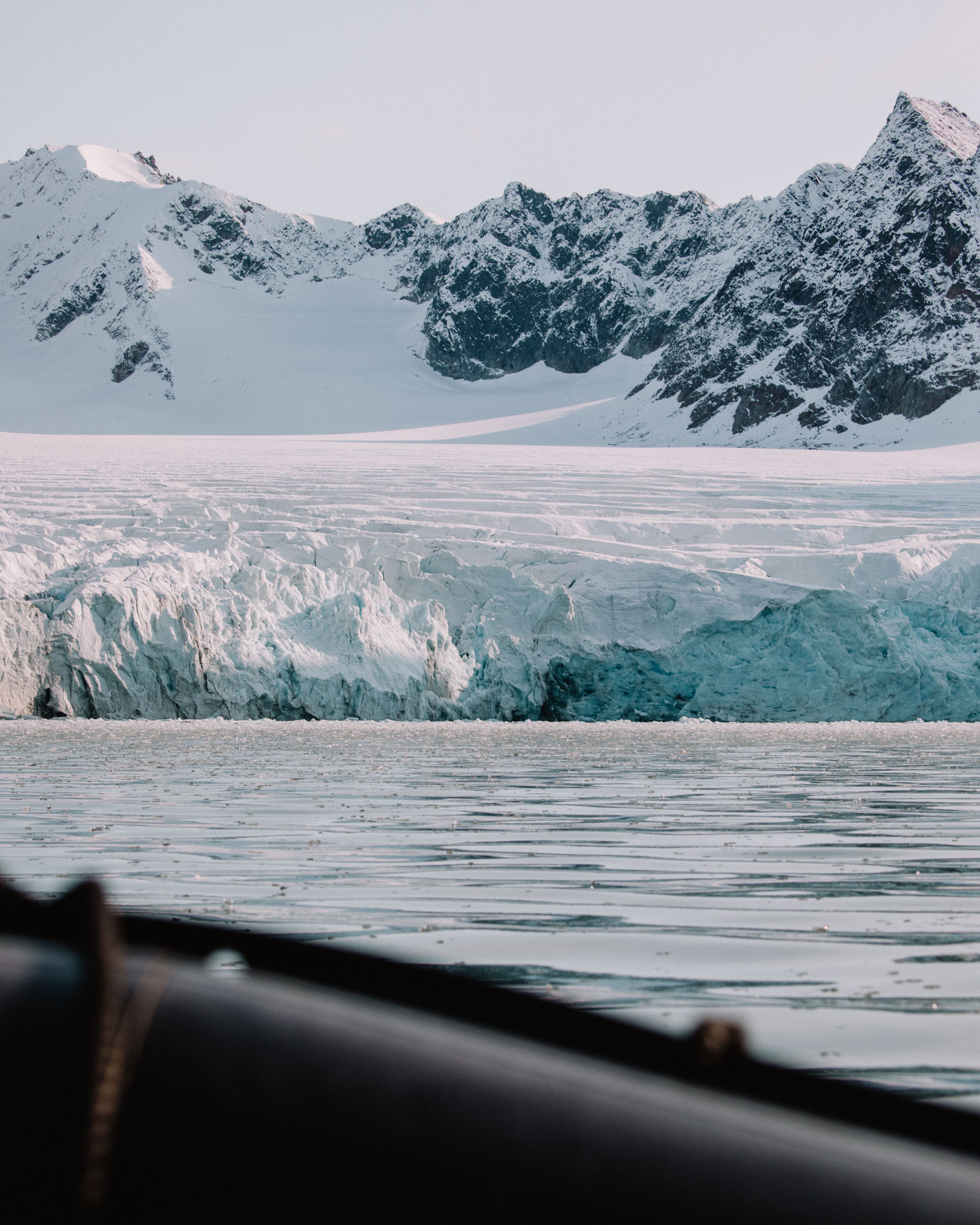 Glacier in Svalbard, Spitsbergen from a boat with blue layers of ice