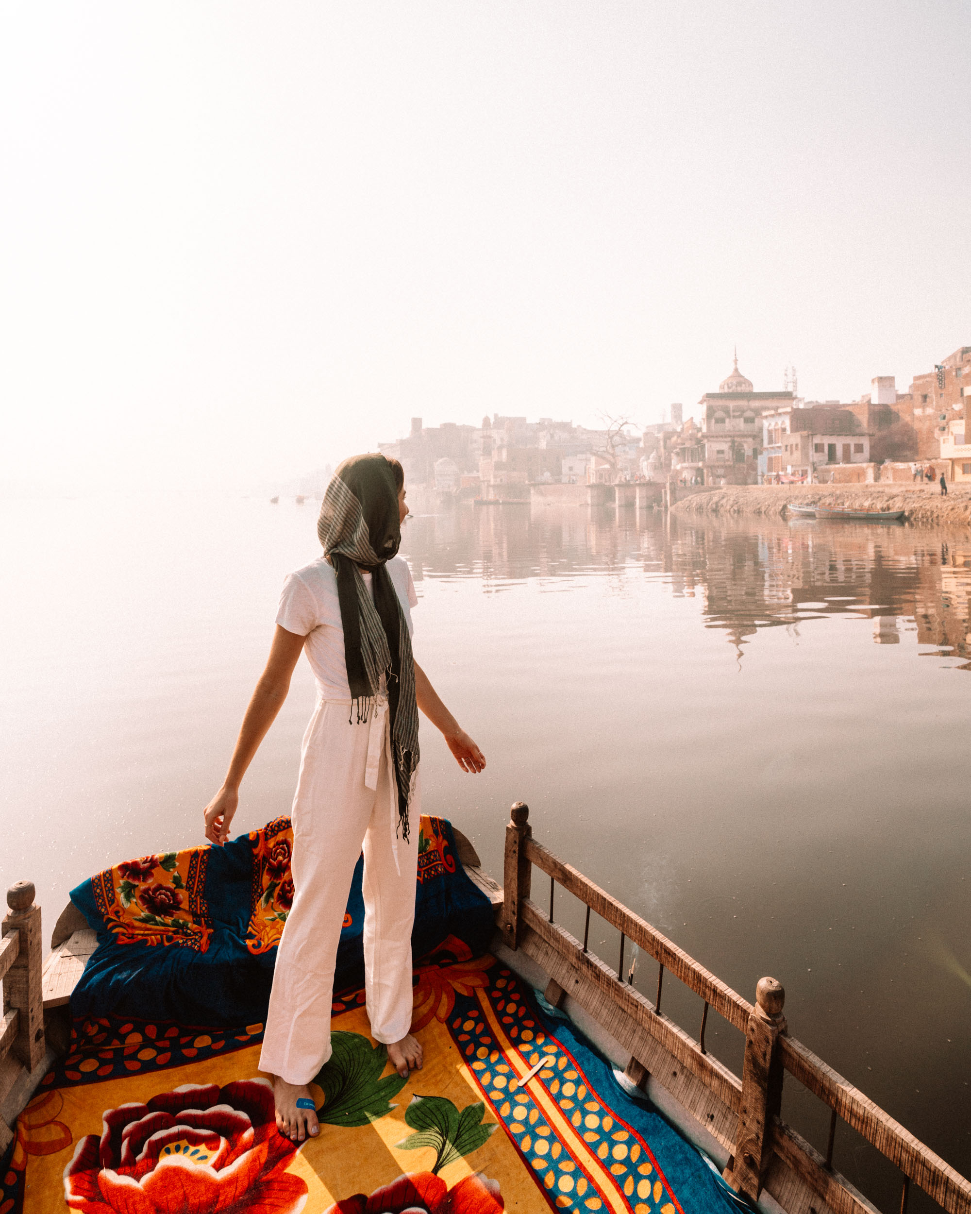 Woman on boat looking at the riverbank of Mathura, India via @finduslost