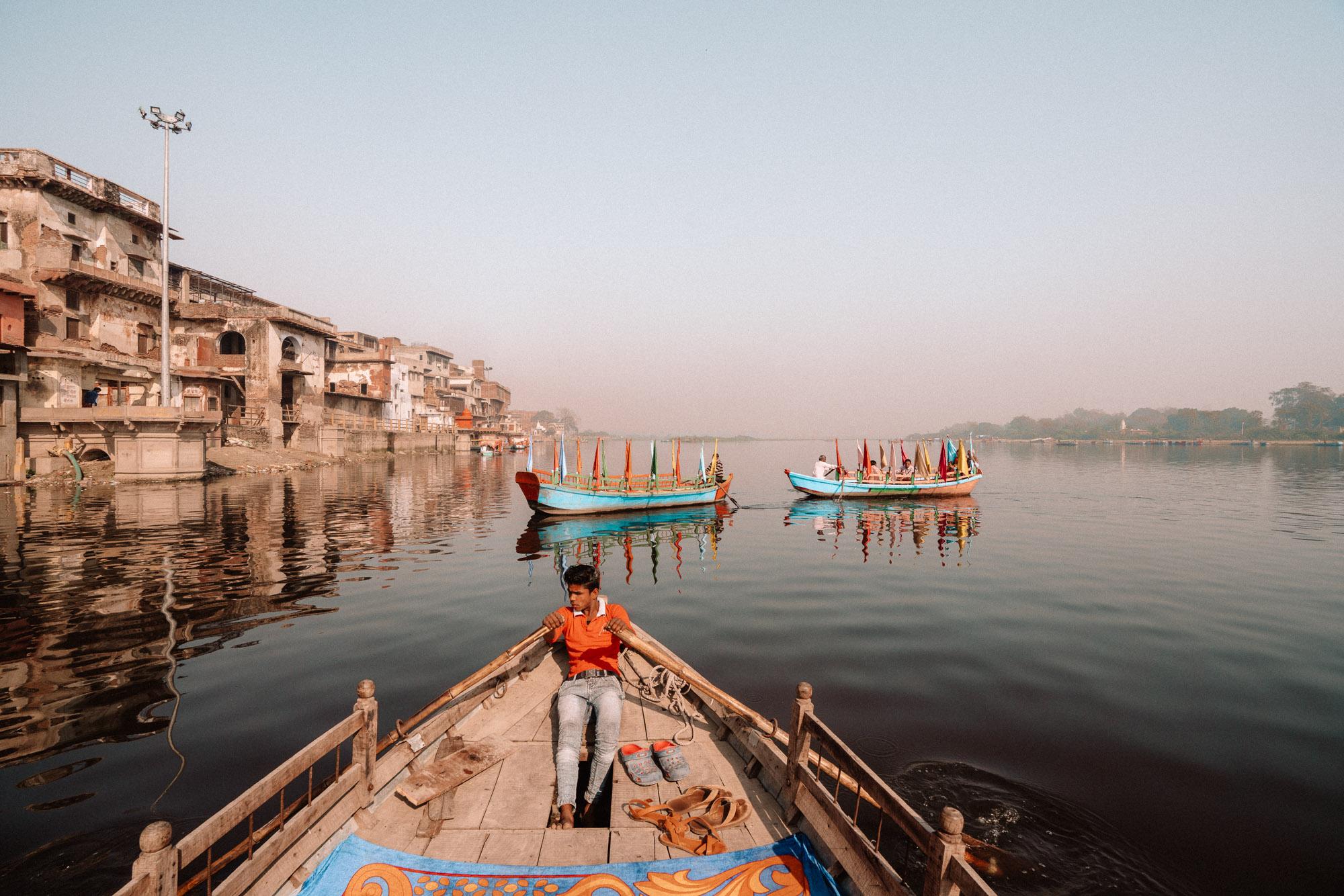 Man steering boat in Mathura, India via @finduslost