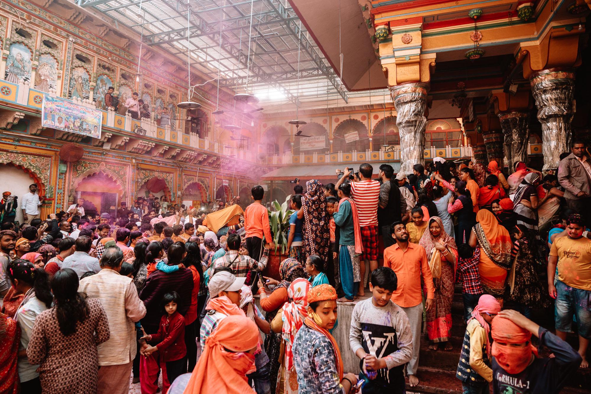 People celebrating Holi Festival in Dwarkadhish Temple in Mathura, India